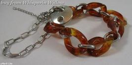 Red and Brown Twisted Oval Acrylic Fashion Bracelet - $16.00