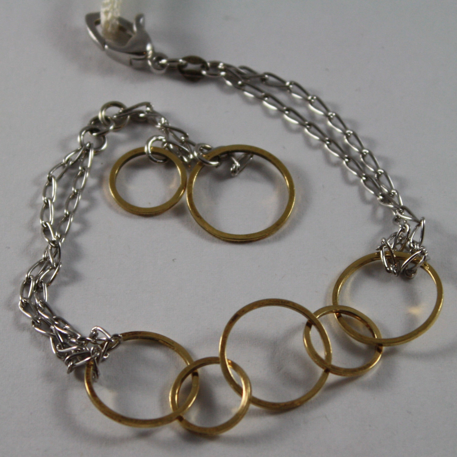 .925 RHODIUM SILVER AND YELLOW GOLD PLATED BRACELET WITH CIRCLES