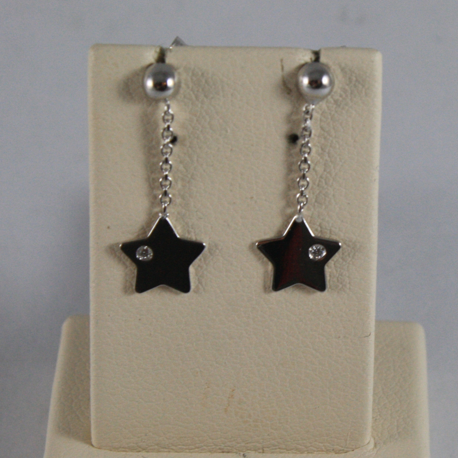 SOLID 18K WHITE GOLD EARRINGS, WITH STAR AND DIAMOND 0,02 CT, MADE IN ITALY