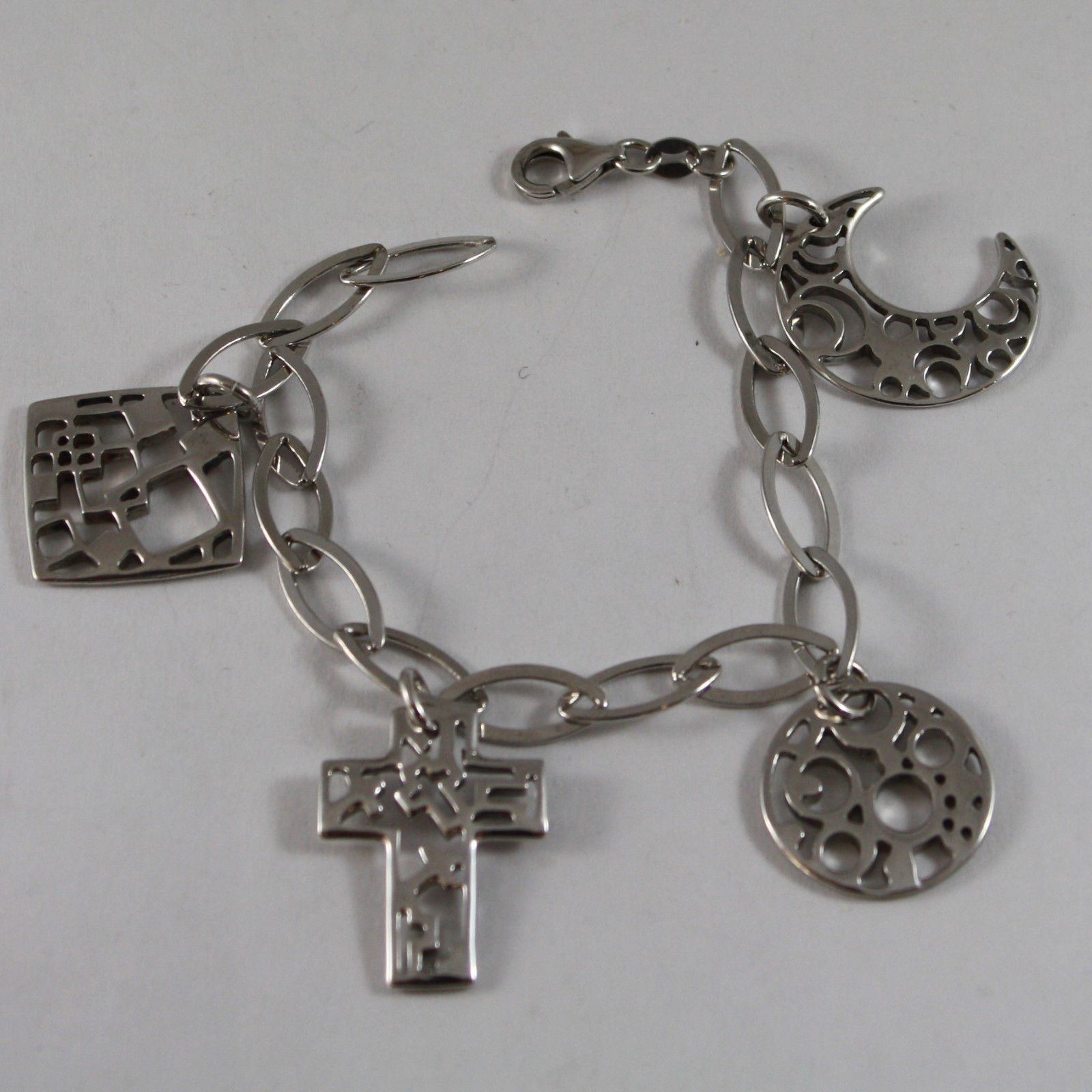 .925 RHODIUM SILVER BRACELET WITH PERFORATED CHARMS