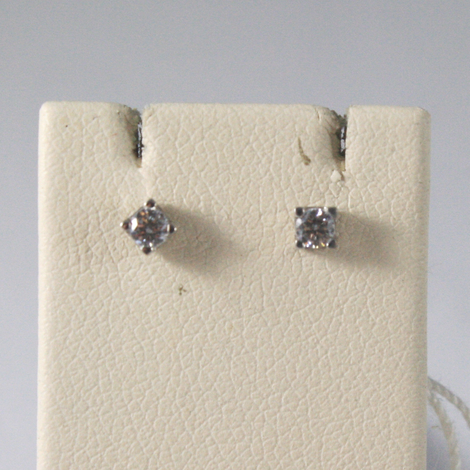 SOLID 18KT. WHITE GOLD EARRINGS WITH ZIRCONIA, WIDTH 0,12 IN, MADE IN ITALY.