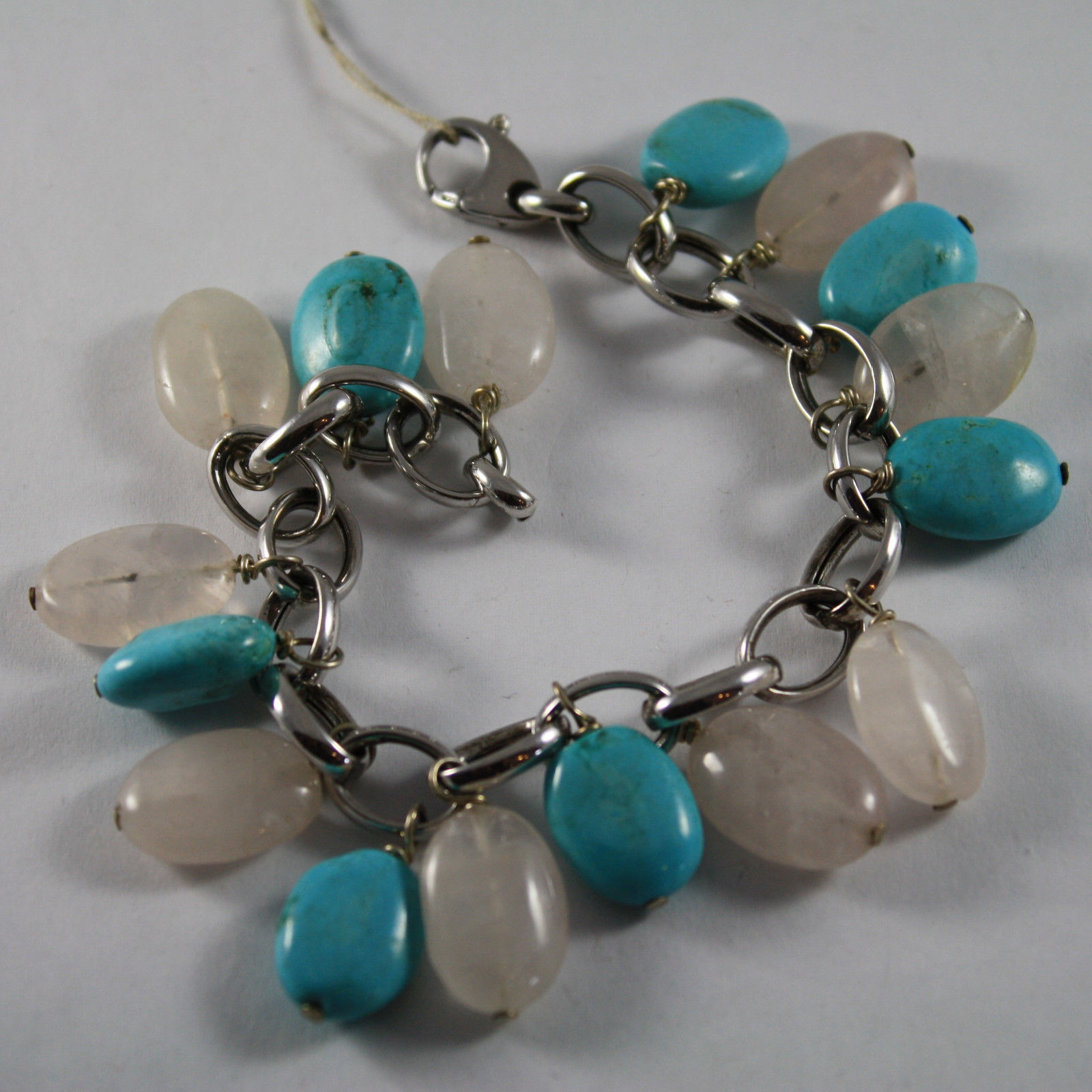 .925 RHODIUM SILVER BRACELET WITH TURQUOISE AND PINK QUARTZ