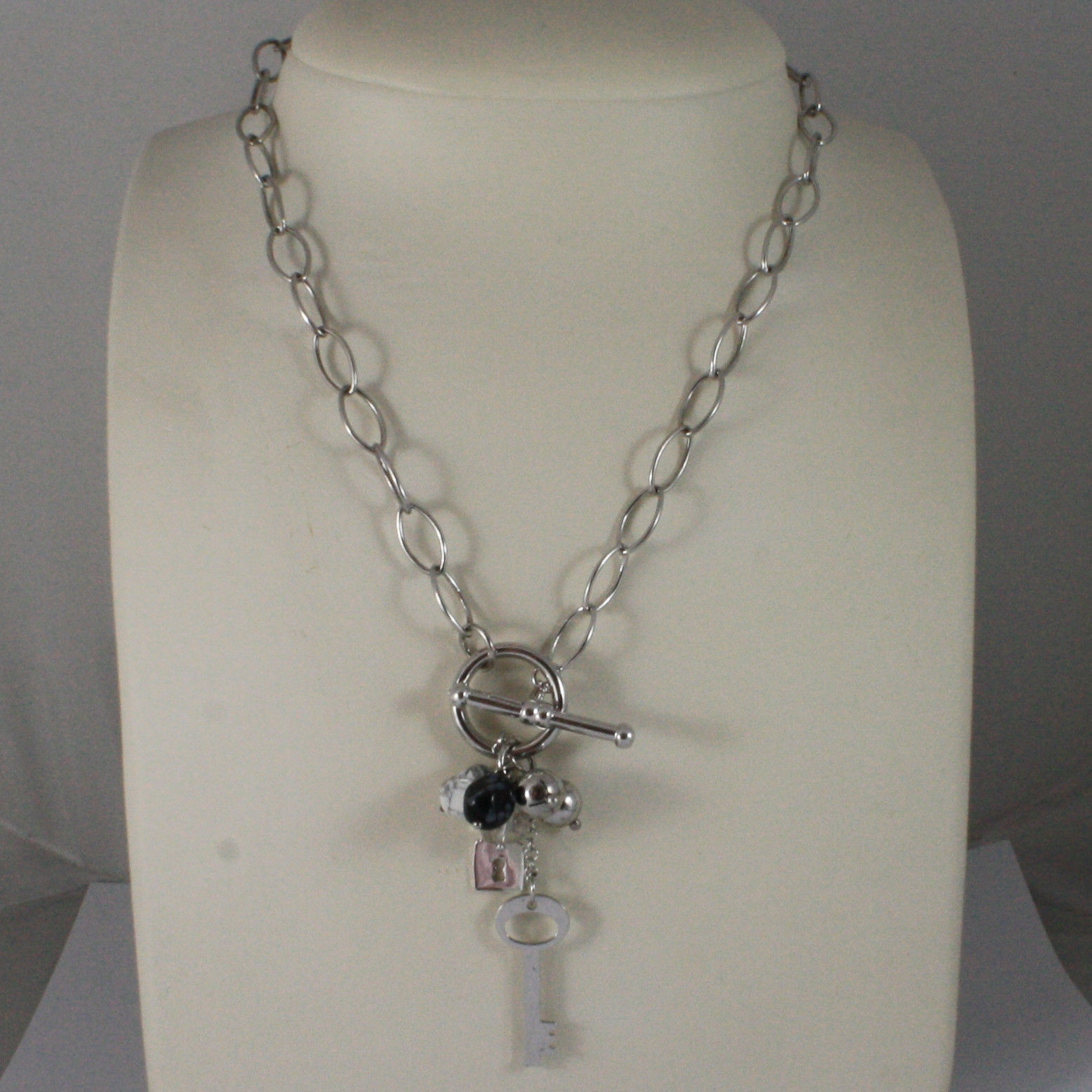 .925 SILVER RHODIUM NECKLACE WITH TRANSPARENT CRISTAL, WHITE HOWLITE AND CHARMS