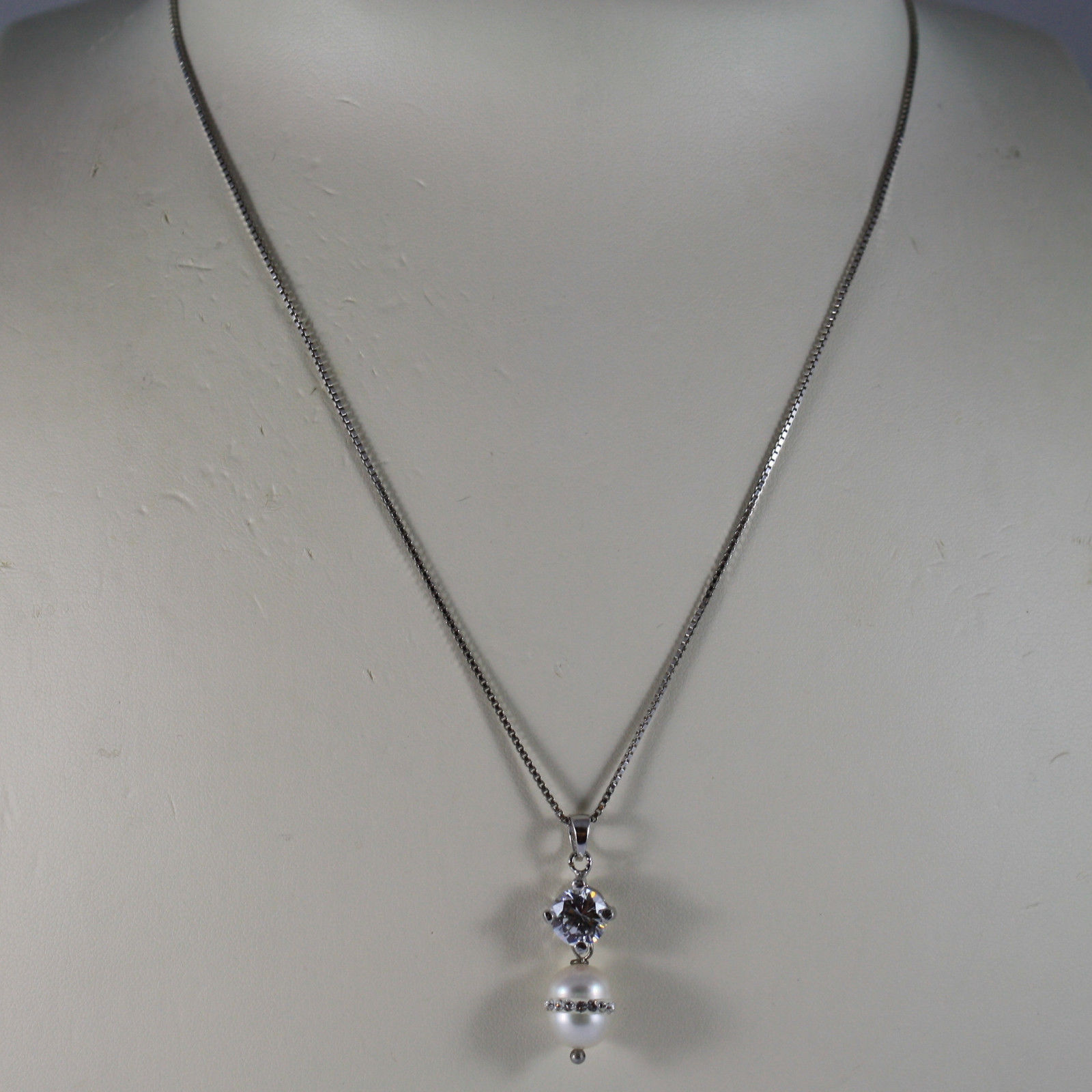 .925 RHODIUM NECKLACE WITH WHITE PEARL WITH ZIRCONS AND CENTRAL CRISTAL