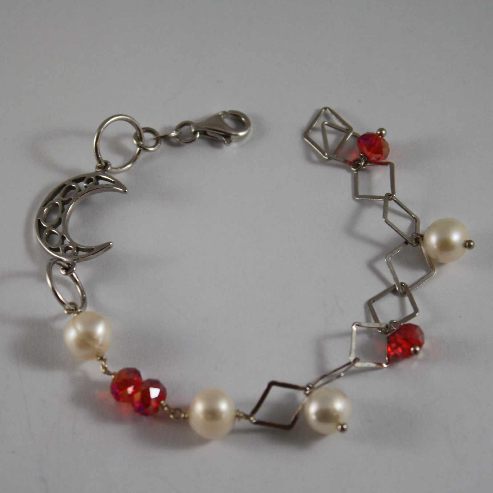 .925 RHODIUM SILVER BRACELET WITH RED CRYSTALS, WHITE PEARLS AND MOON