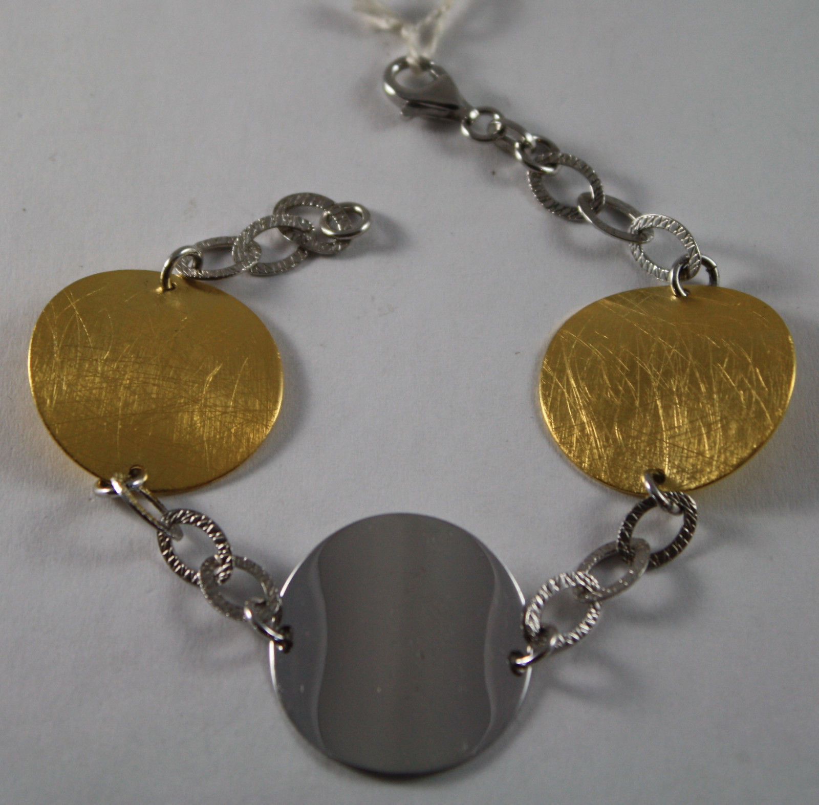 .925 RHODIUM SILVER AND YELLOW GOLD PLATED BRACELET WITH DISCS