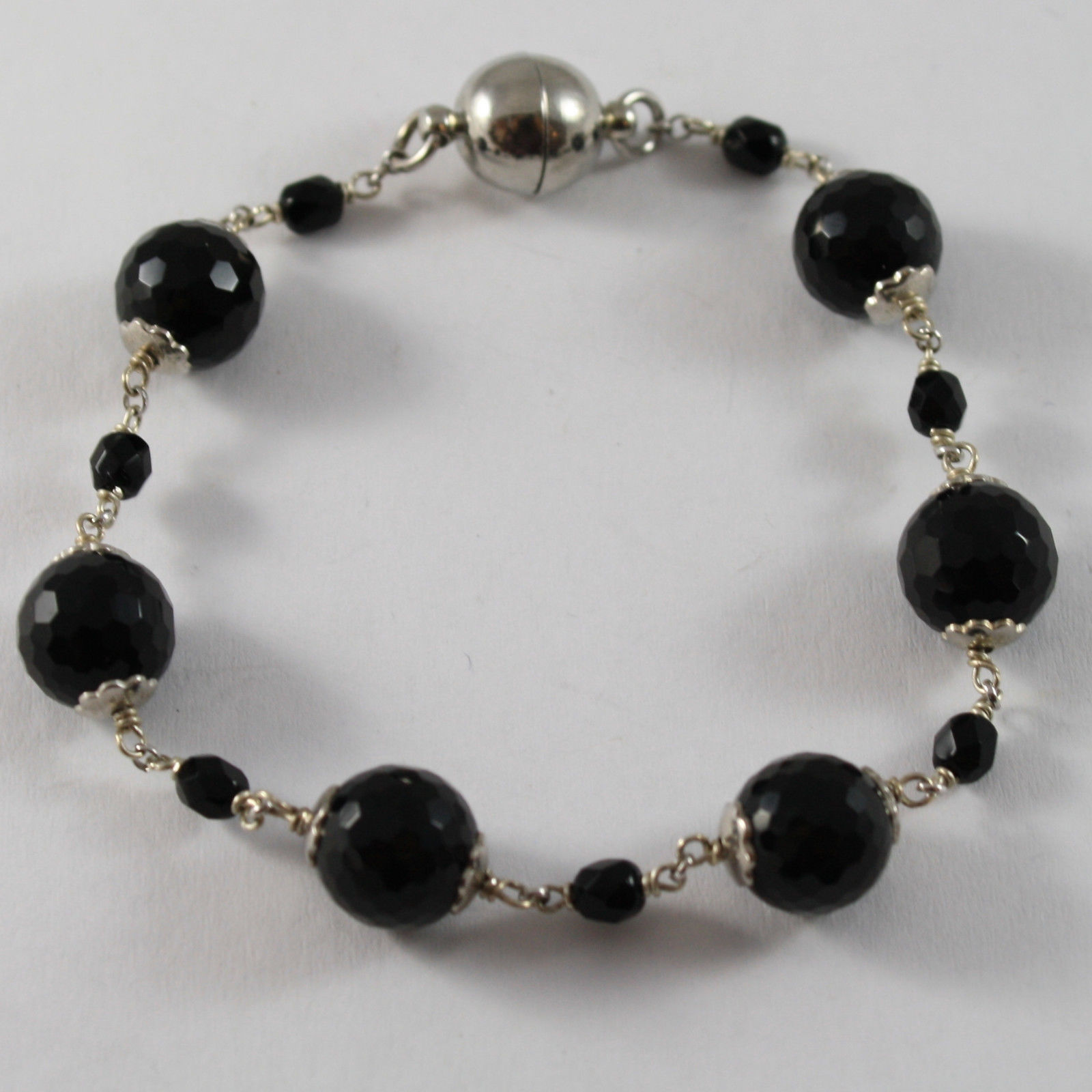 .925 RHODIUM SILVER BRACELET WITH FACETED BLACK ONYX AND CLOSING WITH MAGNET
