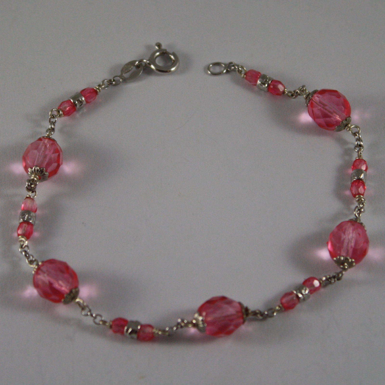 .925 RHODIUM SILVER BRACELET WITH FUCHSIA CRYSTALS