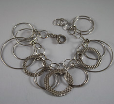 .925 RHODIUM SILVER BRACELET WITH HAMMERED CIRCLES
