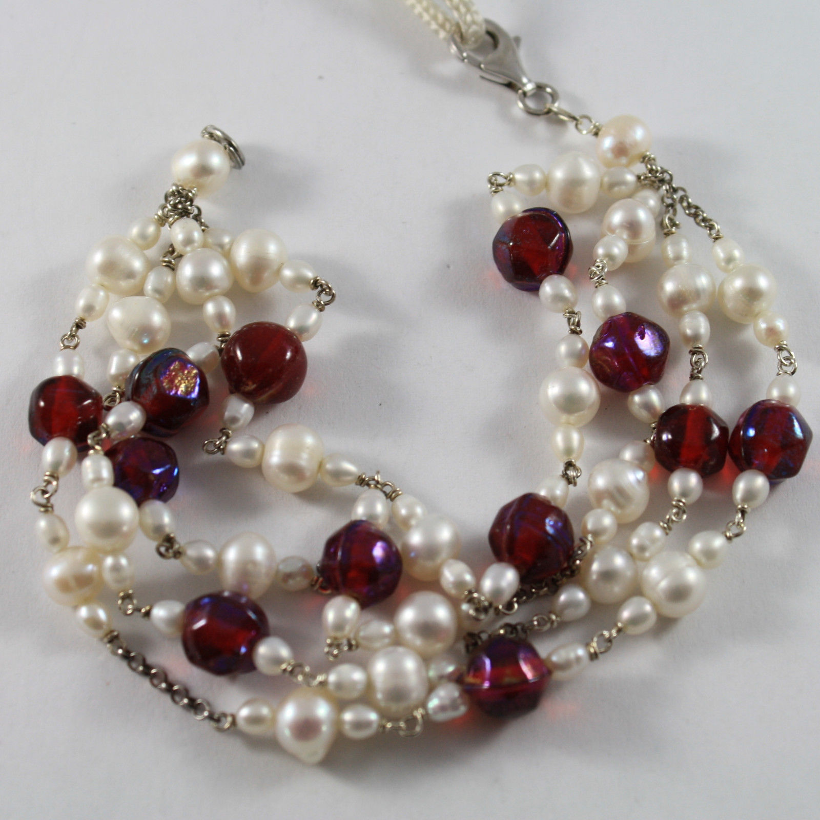 .925 RHODIUM SILVER MULTI STRAND BRACELET WITH WHITE PEARLS AND RED CRYSTAL