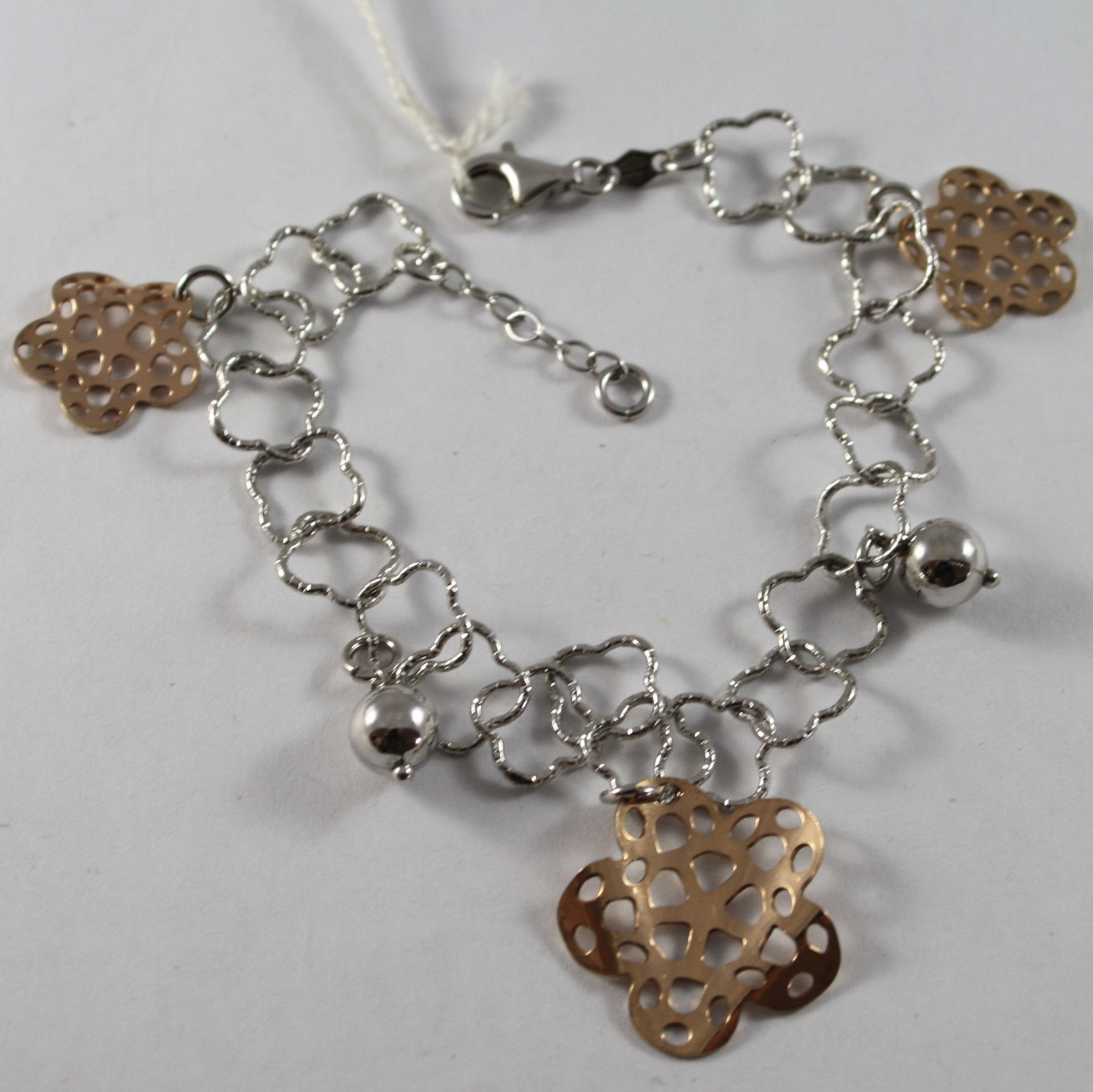 .925 RHODIUM SILVER BRACELET WITH SPHERE AND ROSE PLATED FLOWERS