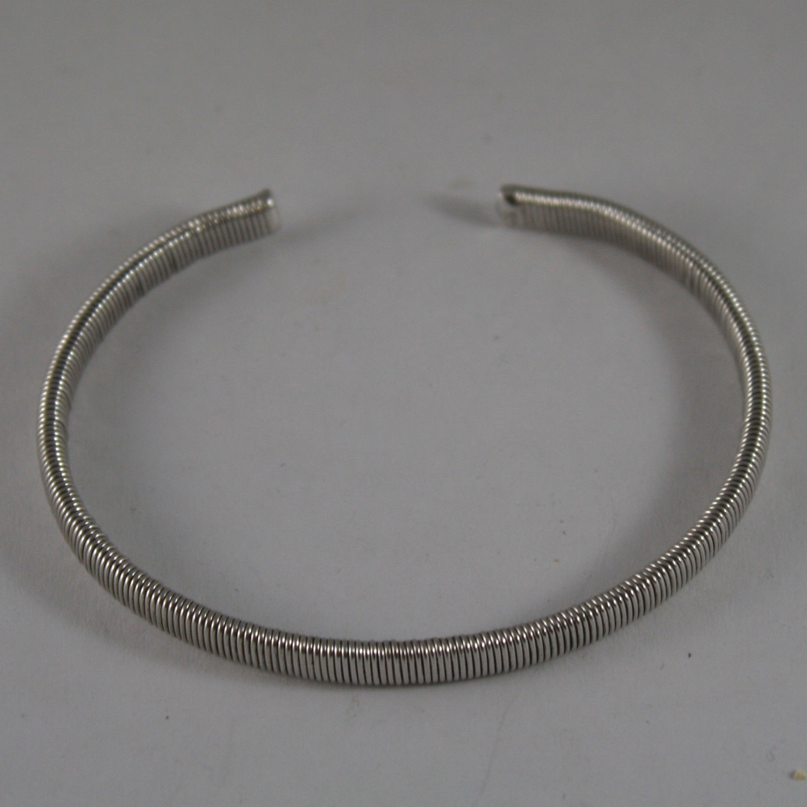 .925 RHODIUM SILVER RIGID BRACELET WITH PROCESSING MILLED SPRING TYPE