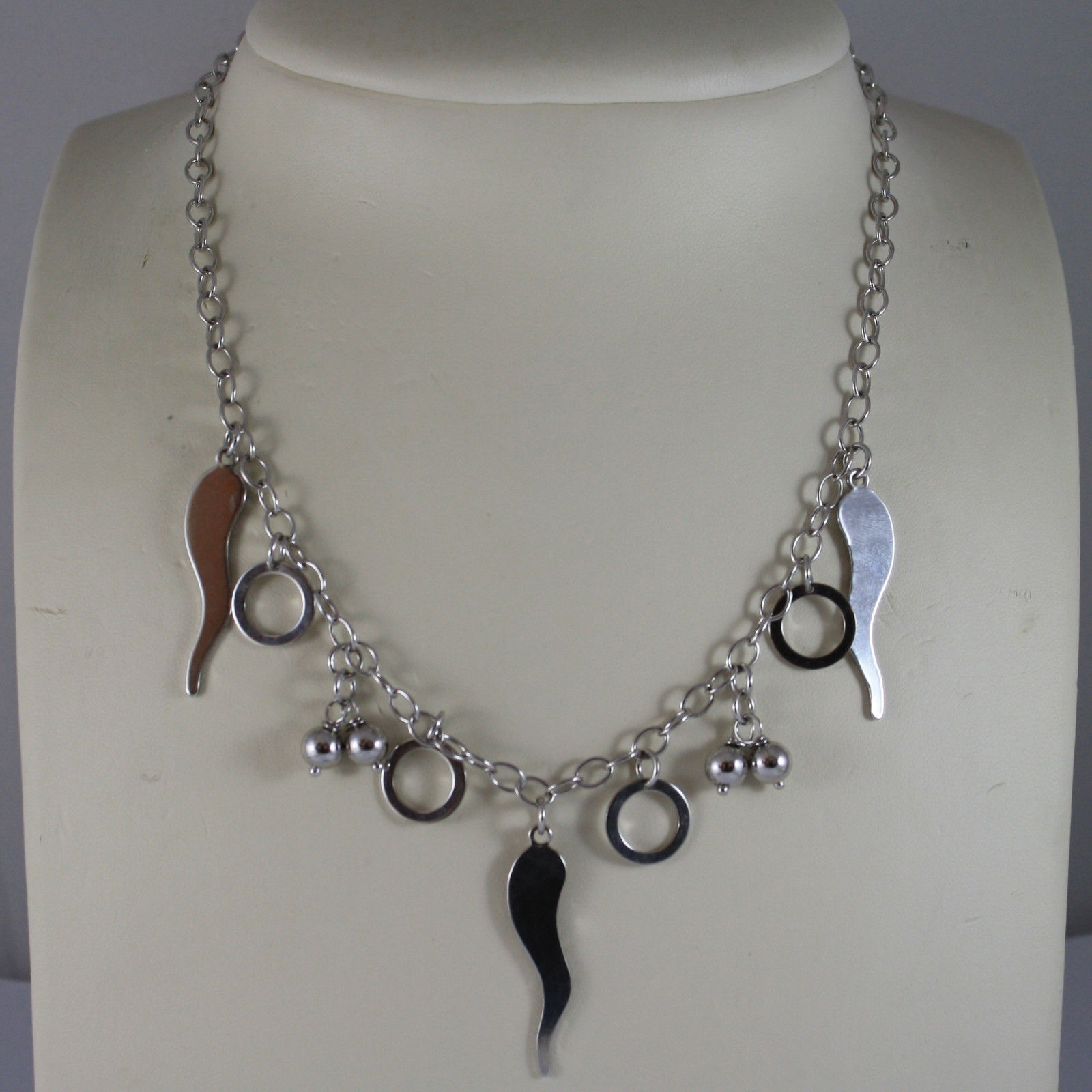 .925 RHODIUM SILVER NECKLACE WITH CHARMS, HORNS, WHEELS AND BALLS