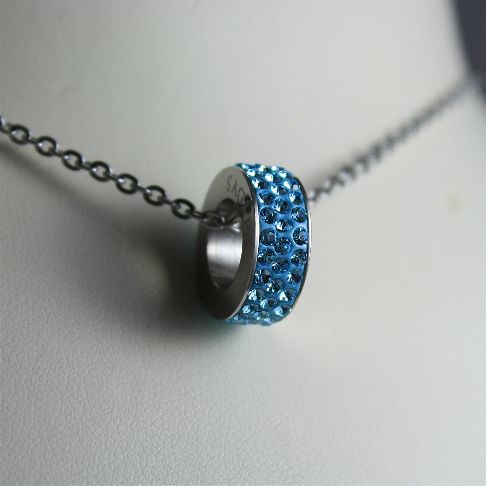 S'AGAPO' NECKLACE, 316L STEEL, LIGHT BLUE PENDANT WITH FACETED CRYSTALS.