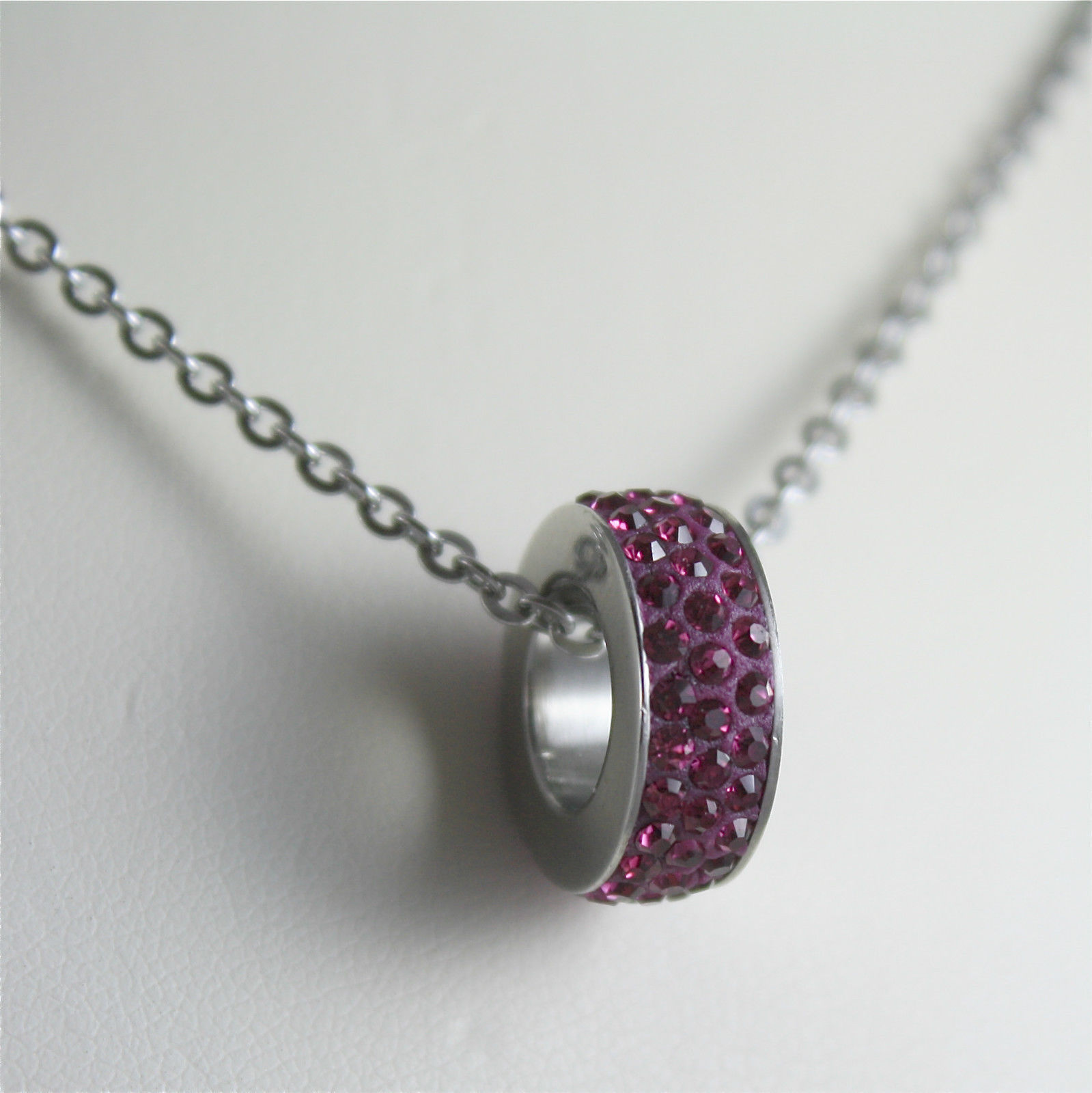 S'AGAPO' NECKLACE, 316L STEEL, FUXIA PENDANT WITH FACETED CRYSTALS.