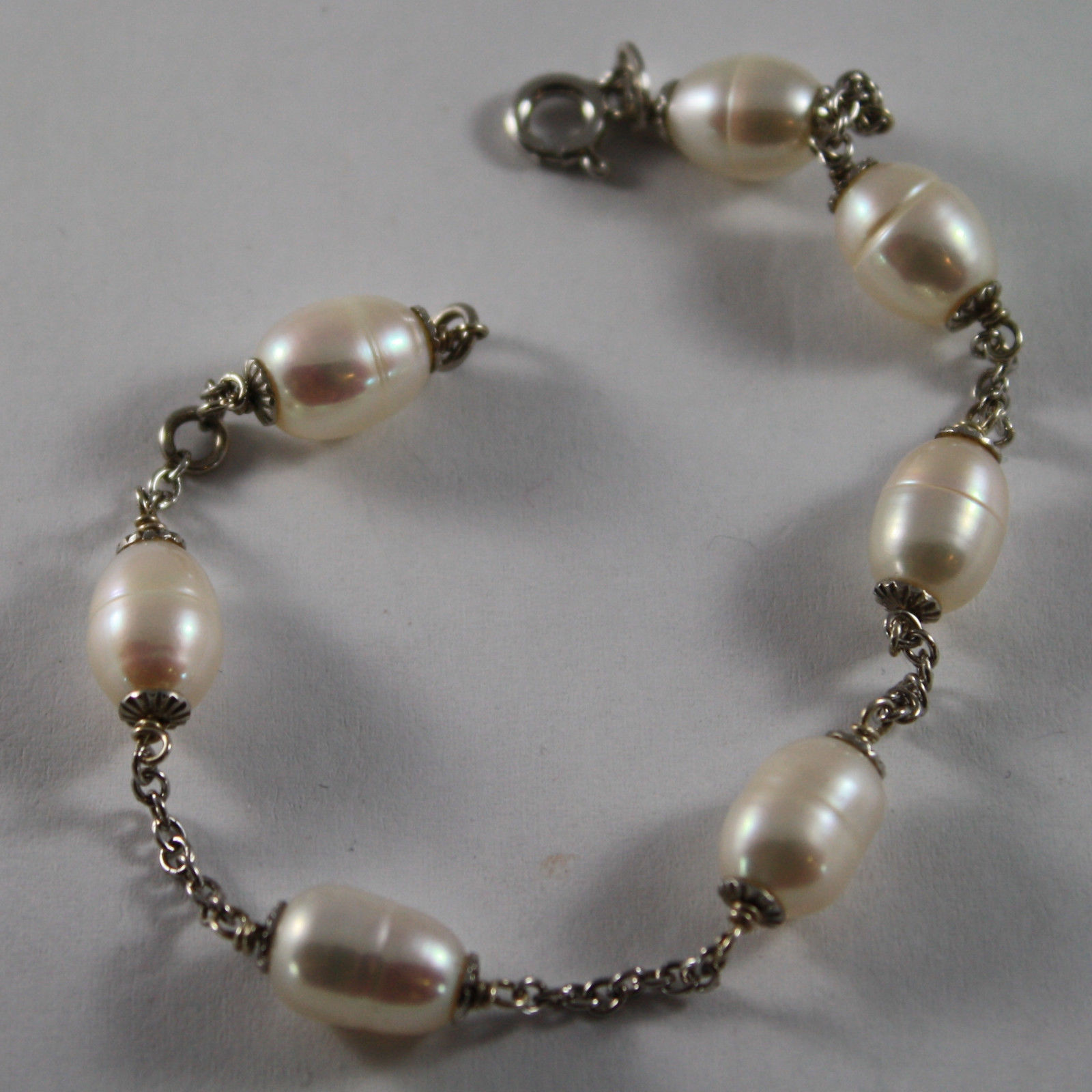 .925 RHODIUM SILVER BRACELET WITH WHITE PEARLS
