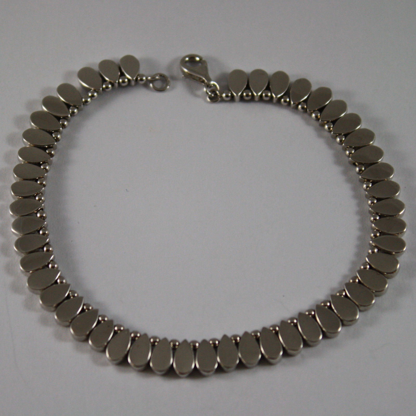 .925 RHODIUM SILVER, SEMIRIGID BRACELET WITH SMALL DROPS