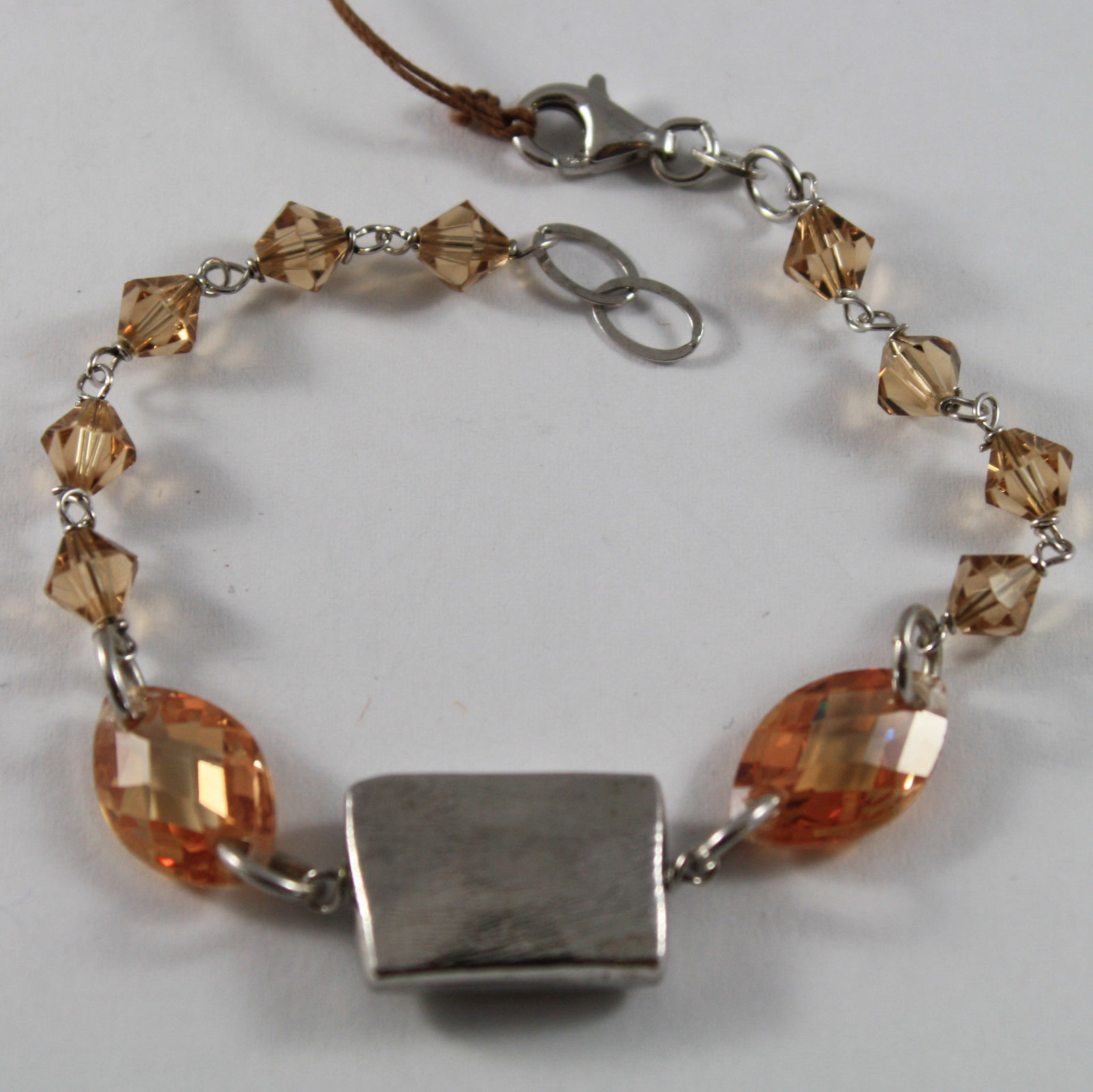 .925 RHODIUM SILVER BRACELET WITH ORANGE FACETED CRISTAL AND SILVER RECTANGLE