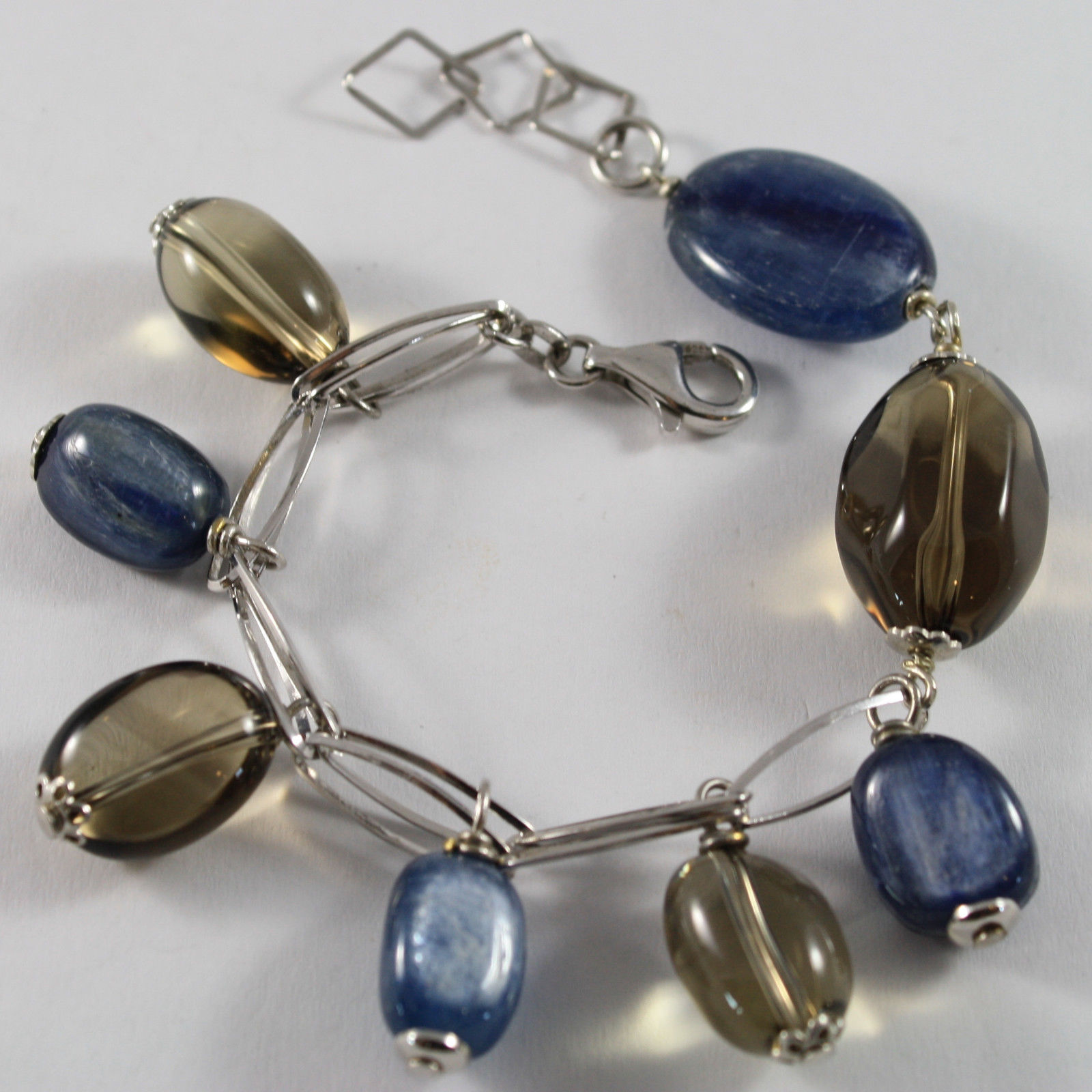 .925 RHODIUM SILVER BRACELET WITH BLUE KYANITE AND LEMON QUARTZ