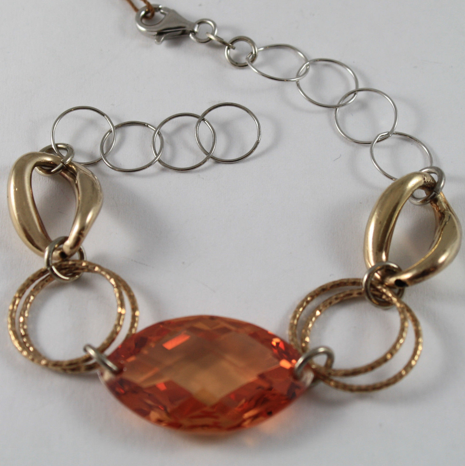 925. RHODIUM WITH PLATED YELLOW GOLD SILVER BRACELET WITH ORANGE CRISTAL