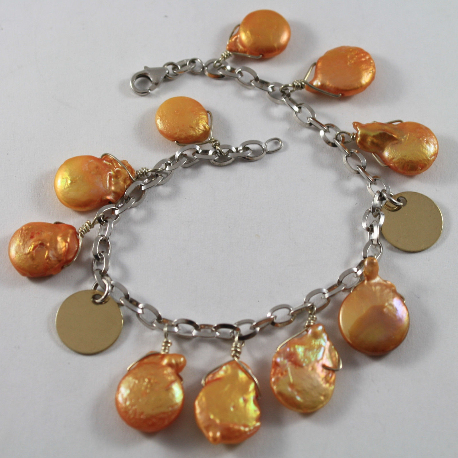 .925 RHODIUM SILVER BRACELET WITH ORANGE MOTHER OF PEARL AND GOLDEN DISC
