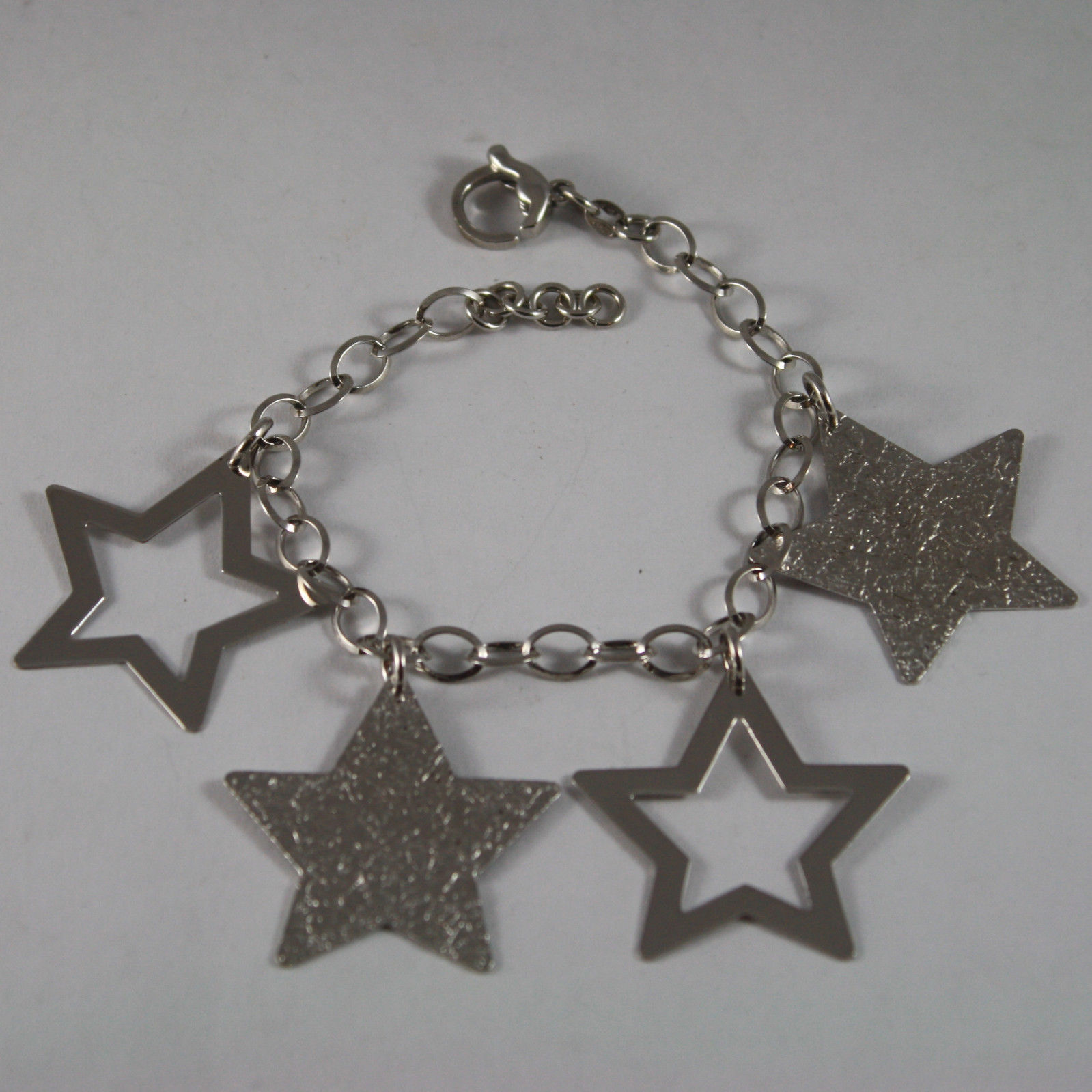 .925 RHODIUM SILVER BRACELET WITH GLOSSY AND HAMMERED STARS