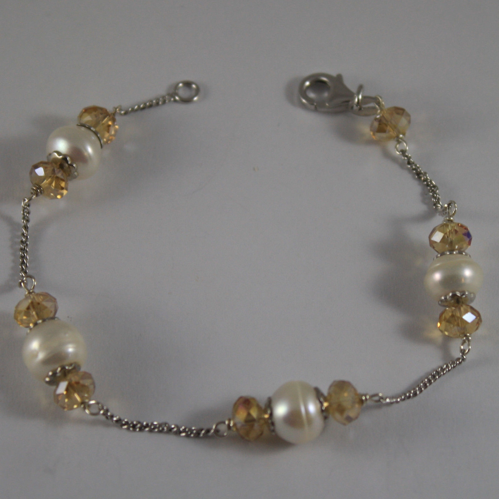 .925 RHODIUM SILVER BRACELET WITH YELLOW CRYSTALS AND WHITE PEARLS