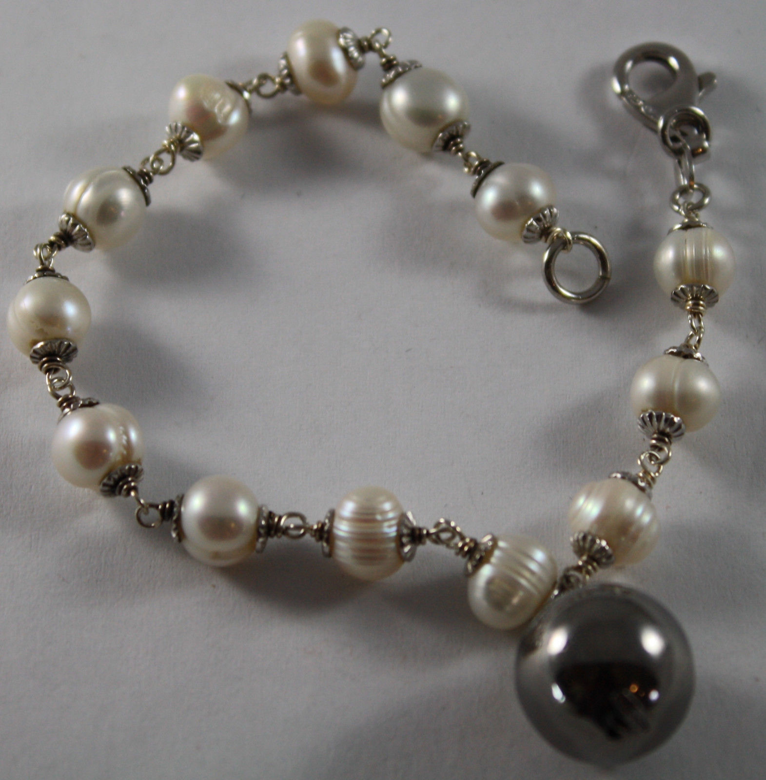 .925 RHODIUM SILVER BRACELET WITH FRESHWATER WHITE PEARLS AND BURNISHED SPHERE