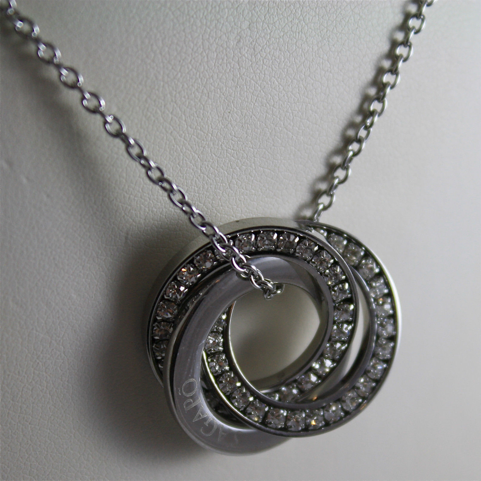 S'AGAPO' NECKLACE, 316L STEEL, TRIPLE CIRCLE, WHITE FACETED CRYSTALS.