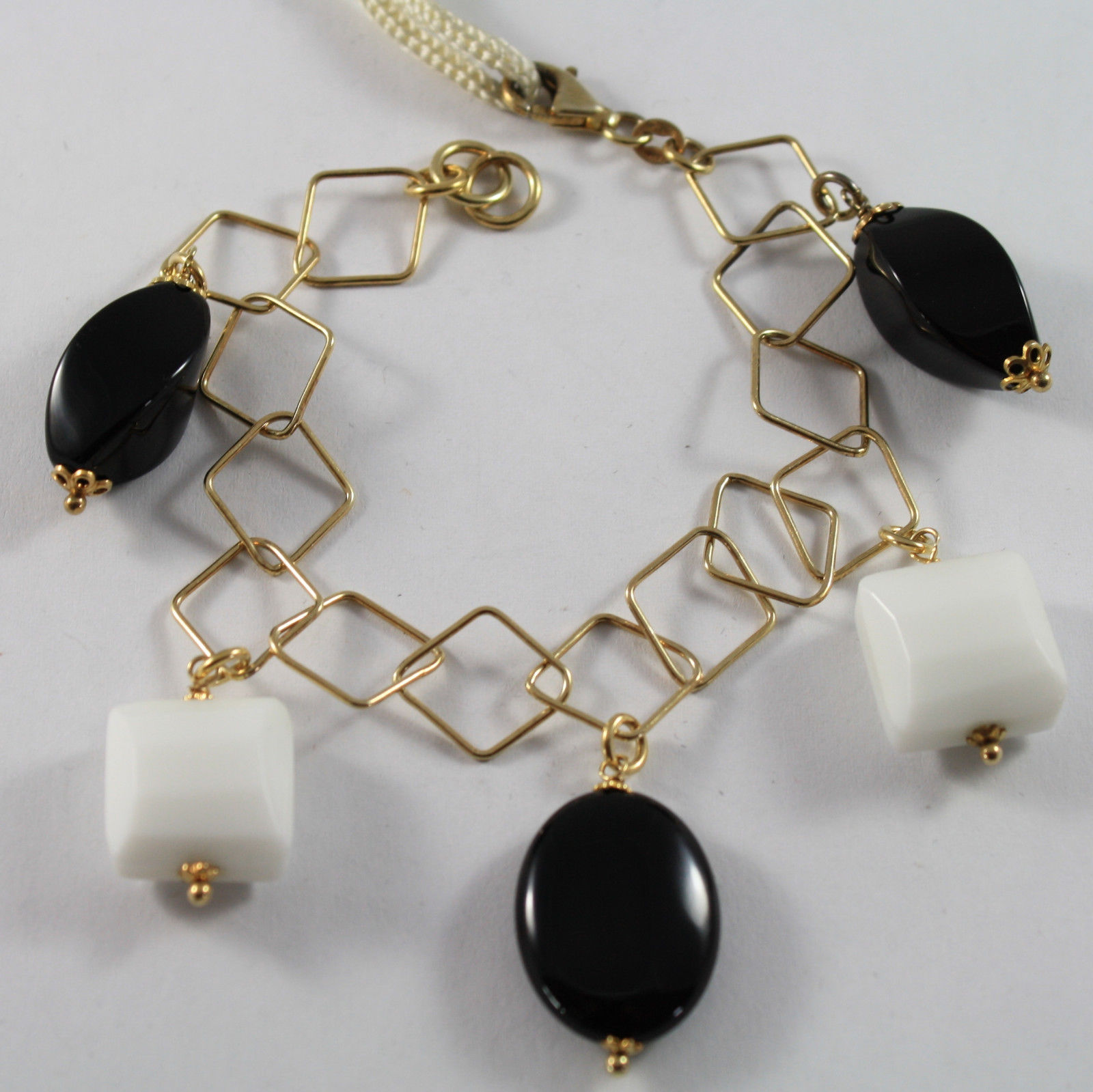 .925 RHODIUM SILVER YELLOW GOLD PLATED BRACELET WITH BLACK ONYX AND WHITE AGATE