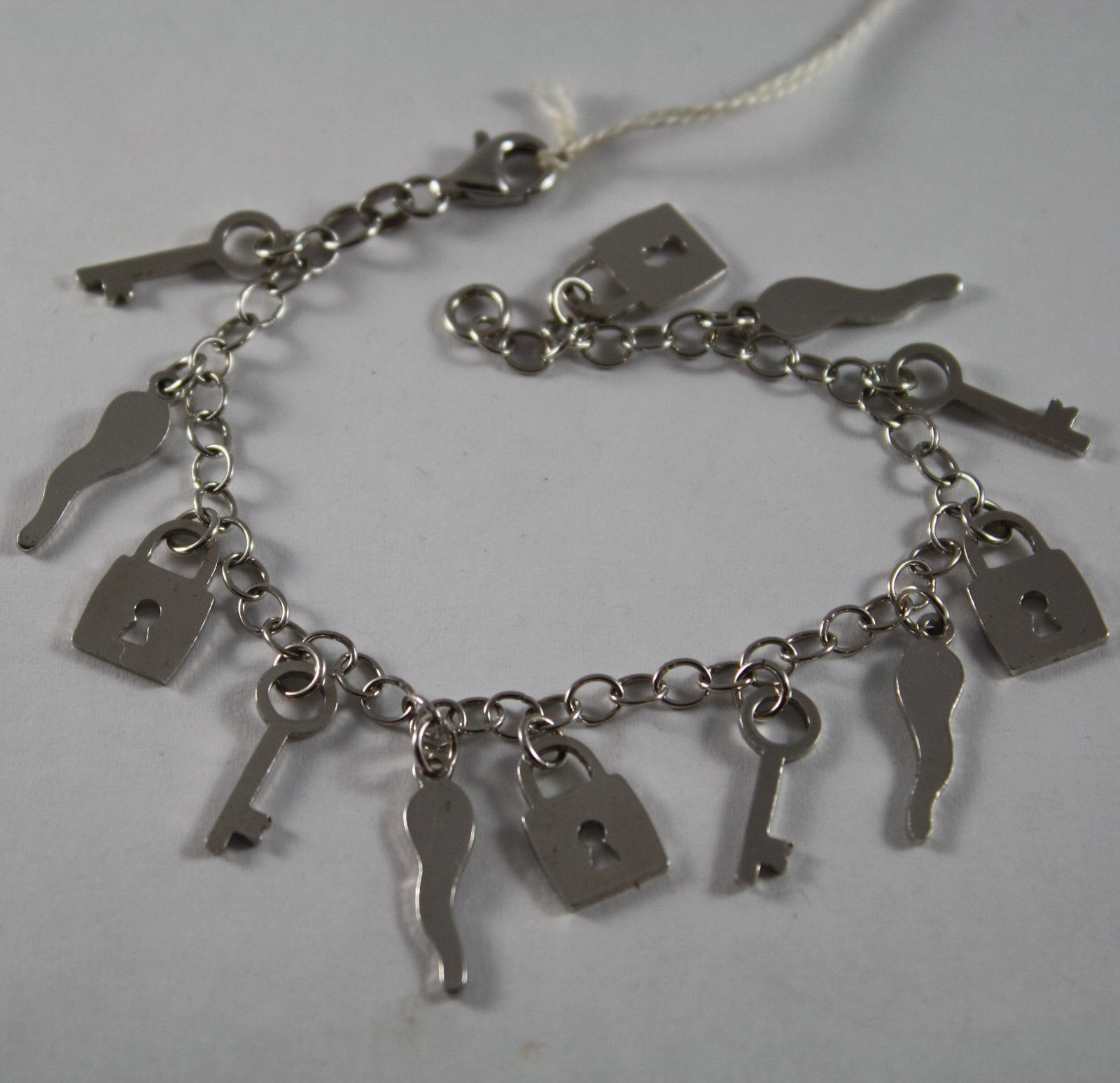 .925 RHODIUM SILVER BRACELET WITH HORNS, KEYS, LOCKS CHARMS