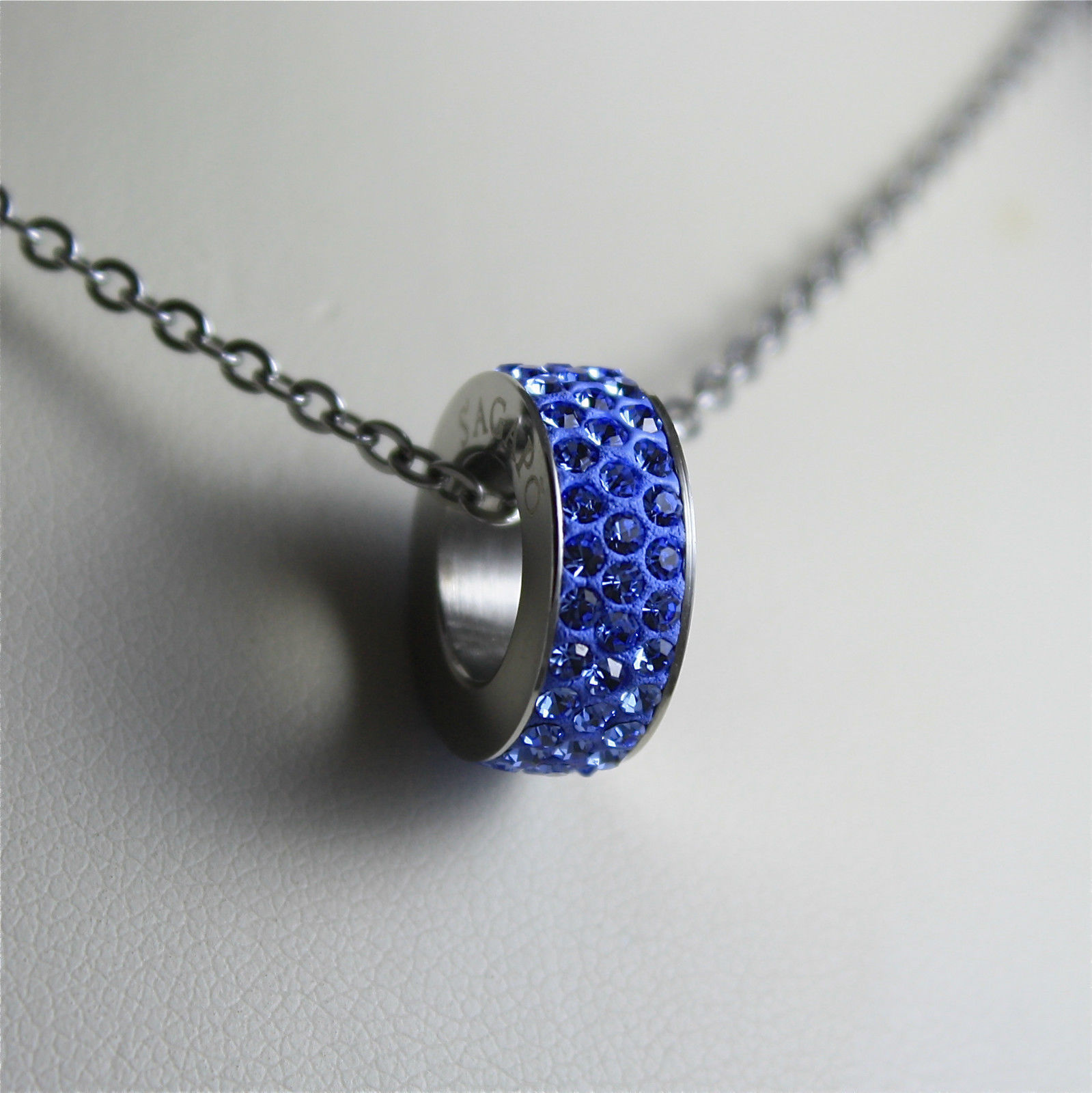 S'AGAPO' NECKLACE, 316L STEEL, BLUE PENDANT WITH FACETED CRYSTALS.