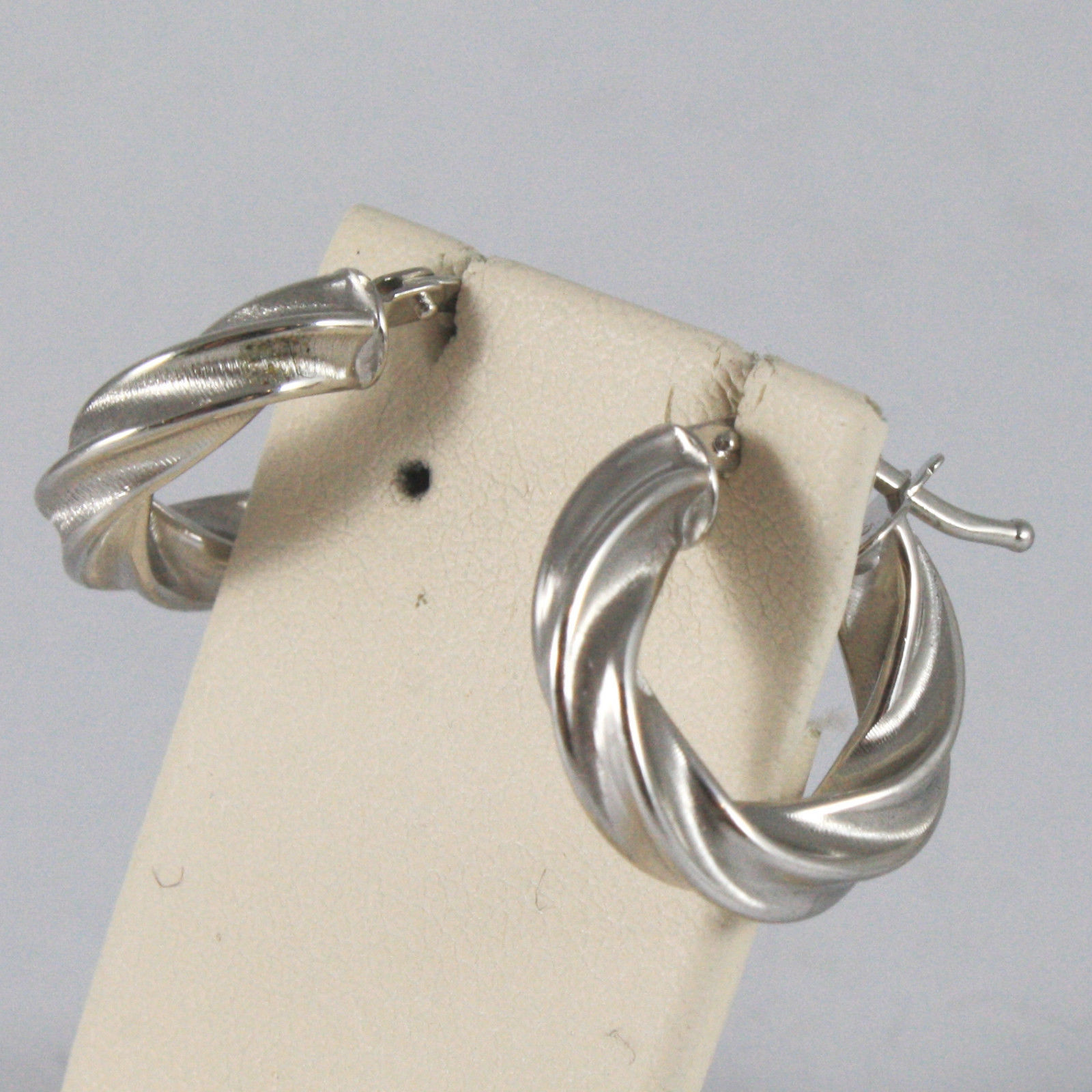 SOLID 18KT. WHITE GOLD CIRCLE EARRINGS, WITH BRAID WORKED, MADE IN ITALY.