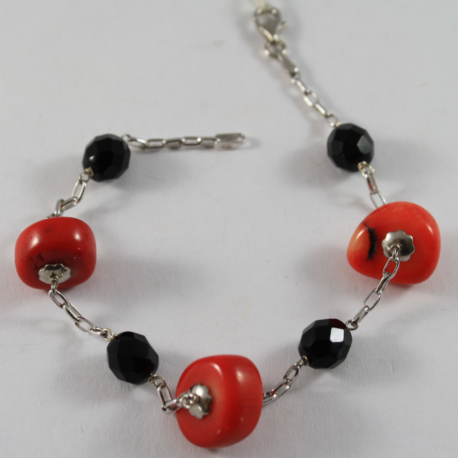 .925 RHODIUM SILVER BRACELET WITH BLACK ONYX AND DISCS OF CORAL BAMBOO