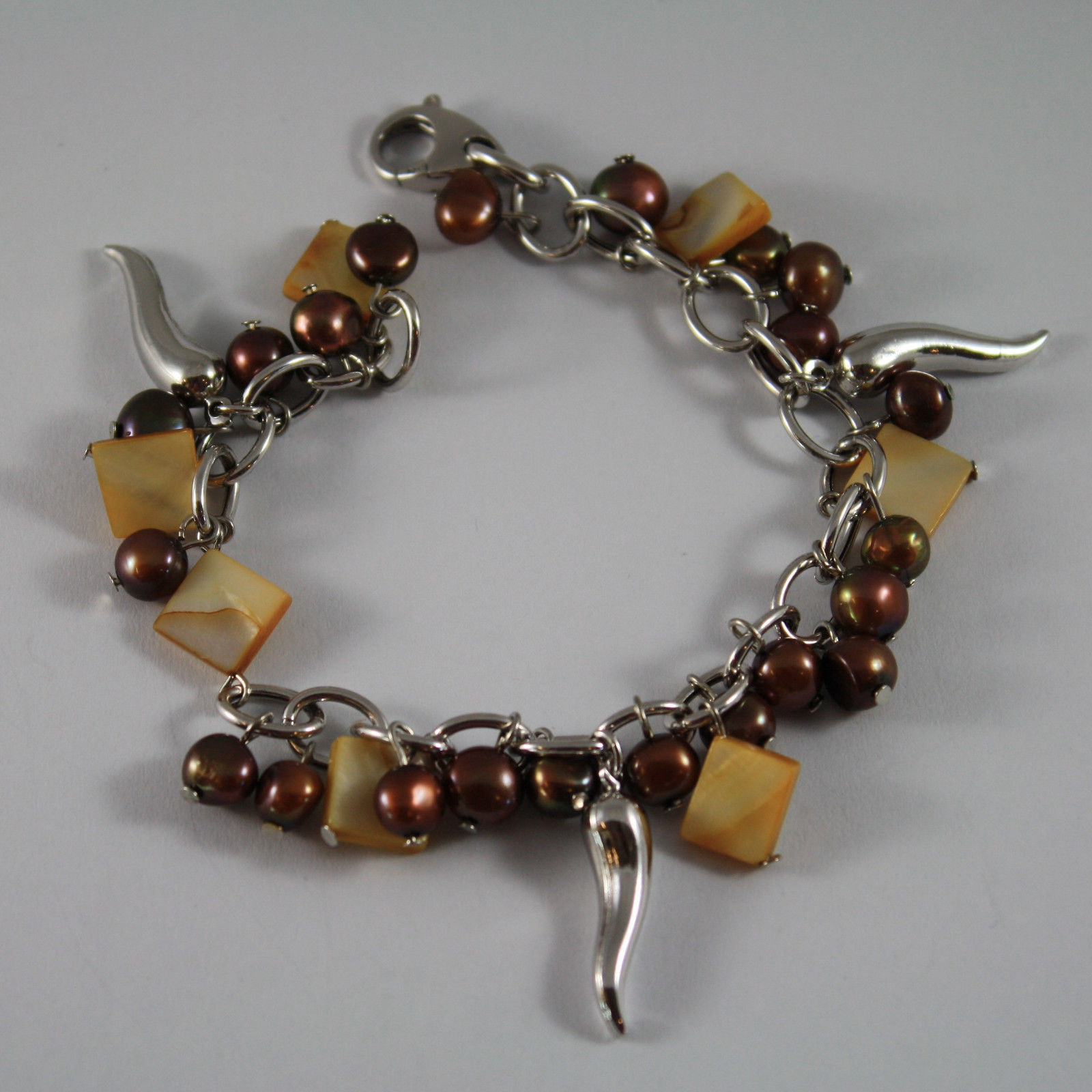 .925 RHODIUM SILVER BRACELET WITH BROWN PEARLS, MOTHER OF PEARL AND HORNS CHARM