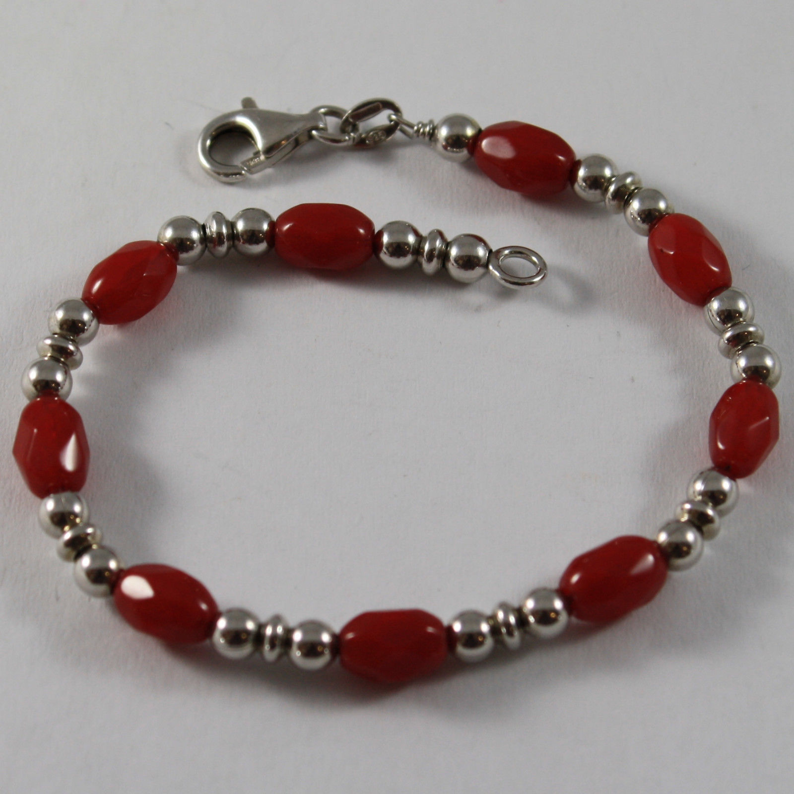 .925 RHODIUM SILVER BRACELET WITH RED  FACETED CRISTAL AND SILVER  SMALL BALL