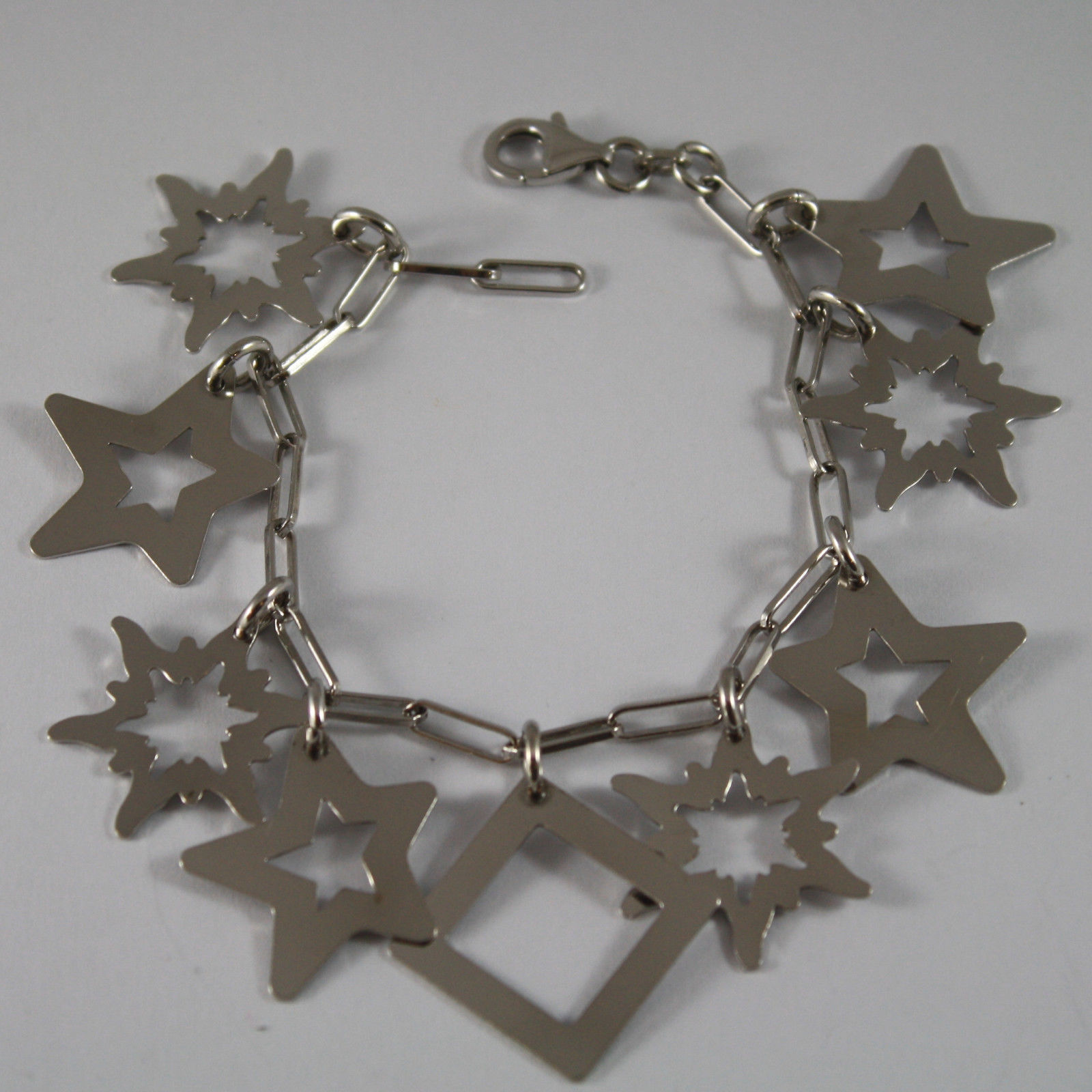 .925 RHODIUM SILVER BRACELET WITH GLOSSY SQUARE AND STARS PENDANT