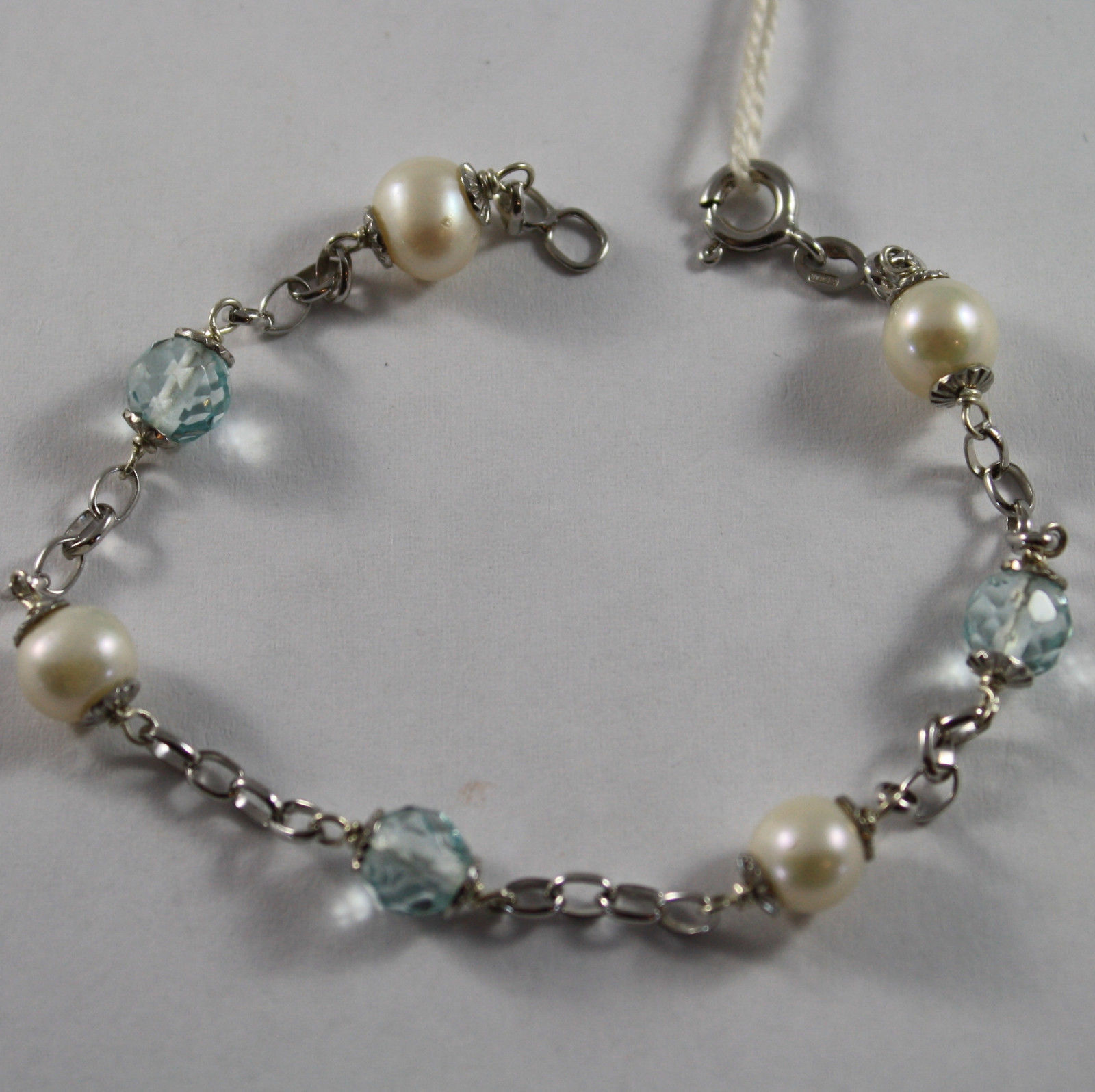 .925 RHODIUM SILVER BRACELET WITH WHITE FRESHWATER PEARLS AND BLUE CRYSTAL