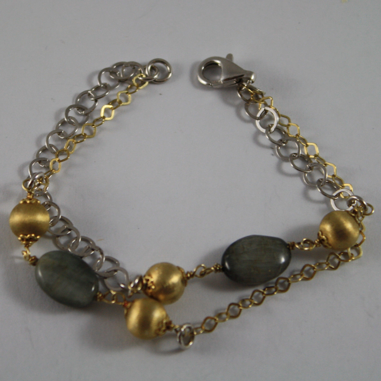 .925 RHODIUM SILVER AND YELLOW GOLD PLATED BRACELET WITH SPHERES AND GRAY QUARTZ