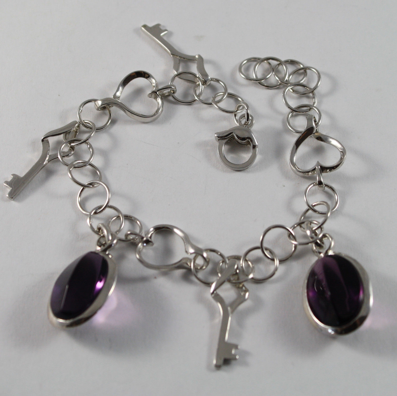 .925 RHODIUM SILVER BRACELET WITH PURPLE CRISTAL AND KEY PENDANTS
