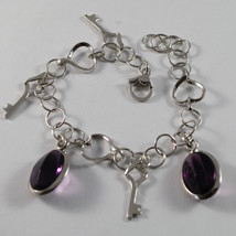 .925 RHODIUM SILVER BRACELET WITH PURPLE CRISTAL AND KEY PENDANTS image 1