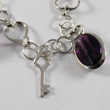 .925 RHODIUM SILVER BRACELET WITH PURPLE CRISTAL AND KEY PENDANTS image 2