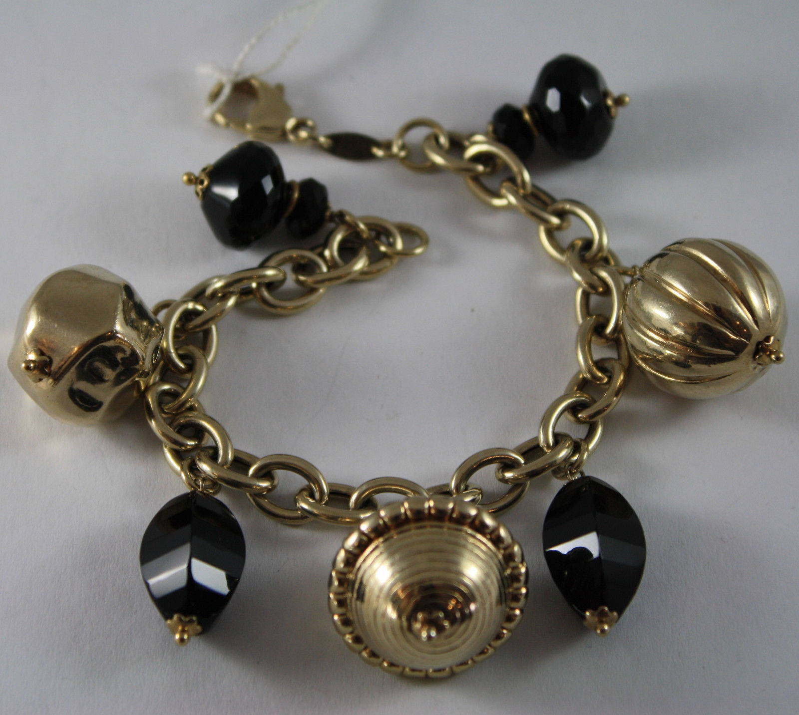 .925 RHODIUM SILVER YELLOW GOLD PLATED BRACELET WITH DROPS OF BLACK ONYX