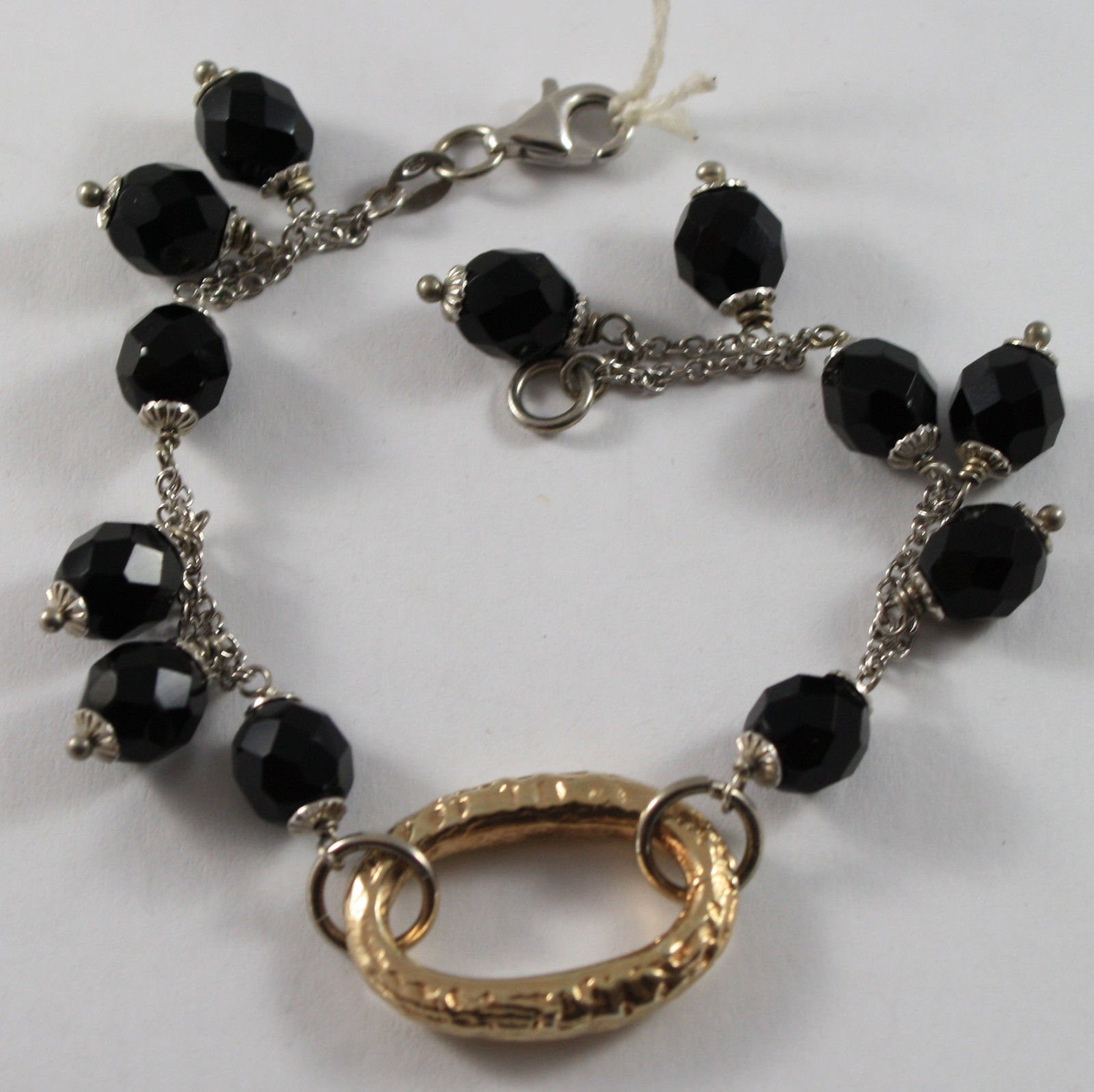 .925 RHODIUM SILVER BRACELET WITH GOLDEN OVAL AND BLACK ONYX