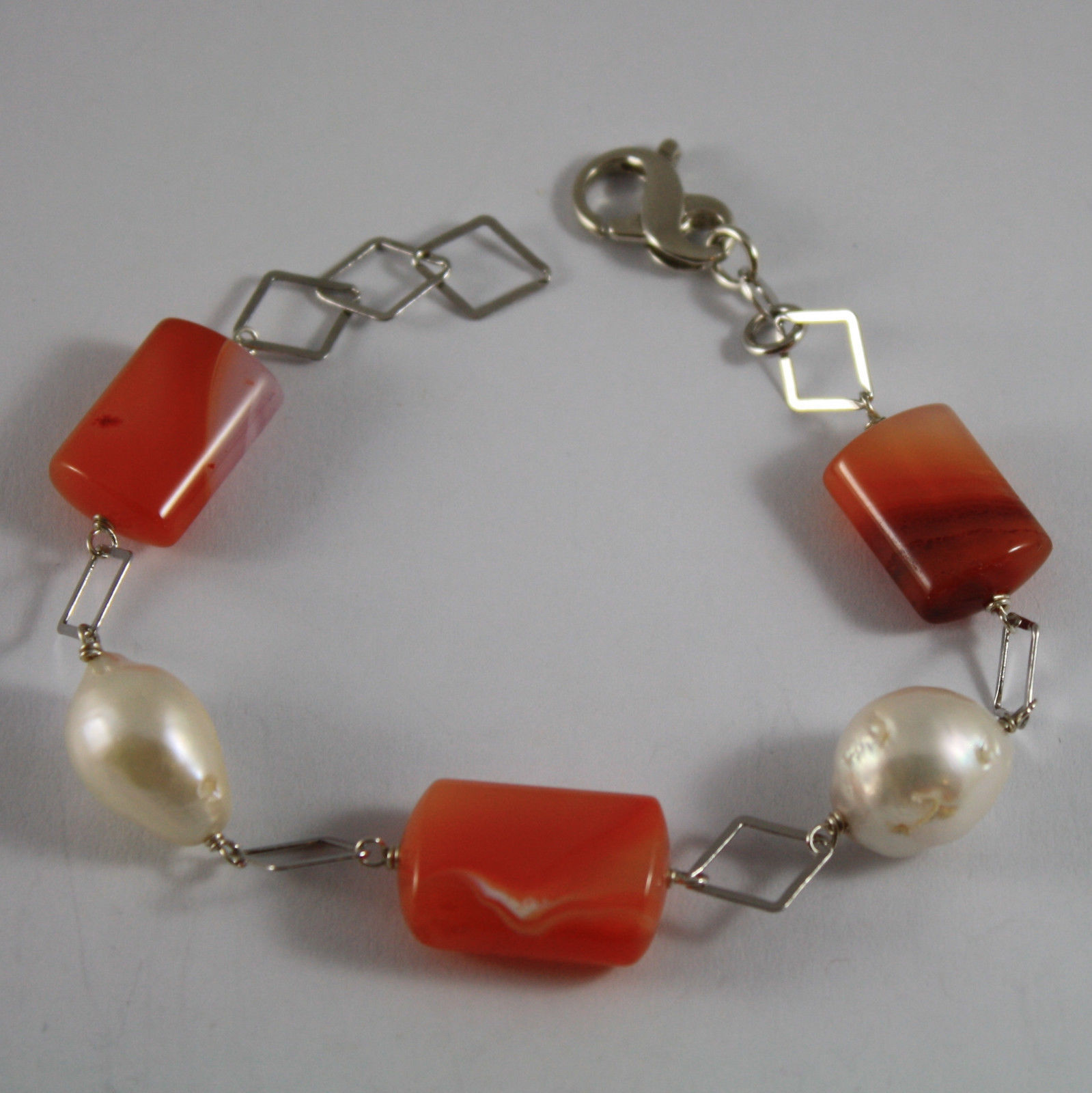 .925 RHODIUM SILVER BRACELET WITH BAROQUE WHITE PEARLS AND ORANGE AGATE