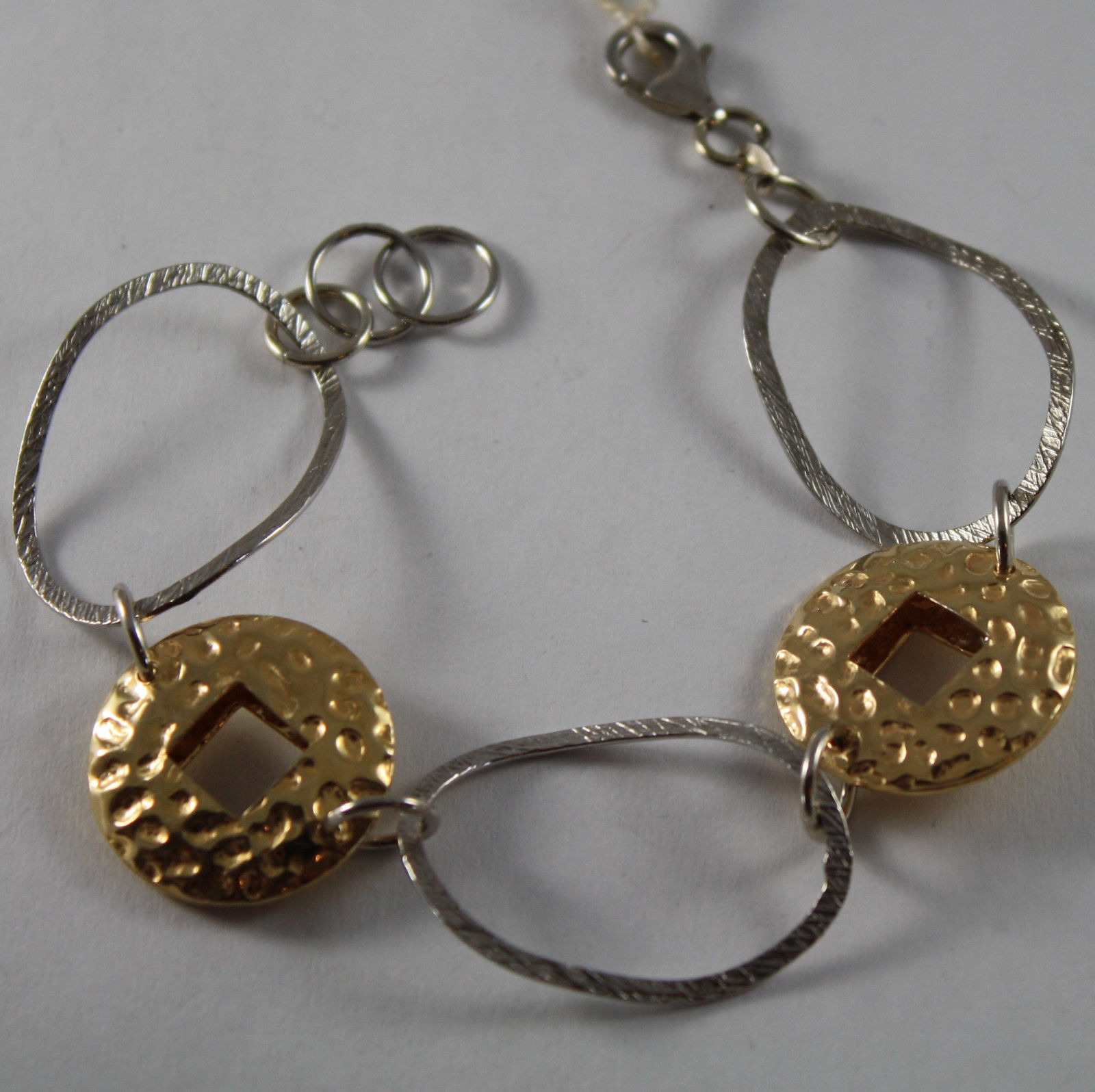 .925 RHODIUM SILVER AND YELLOW GOLD PLATED BRACELET WITH DISCS AND OVAL