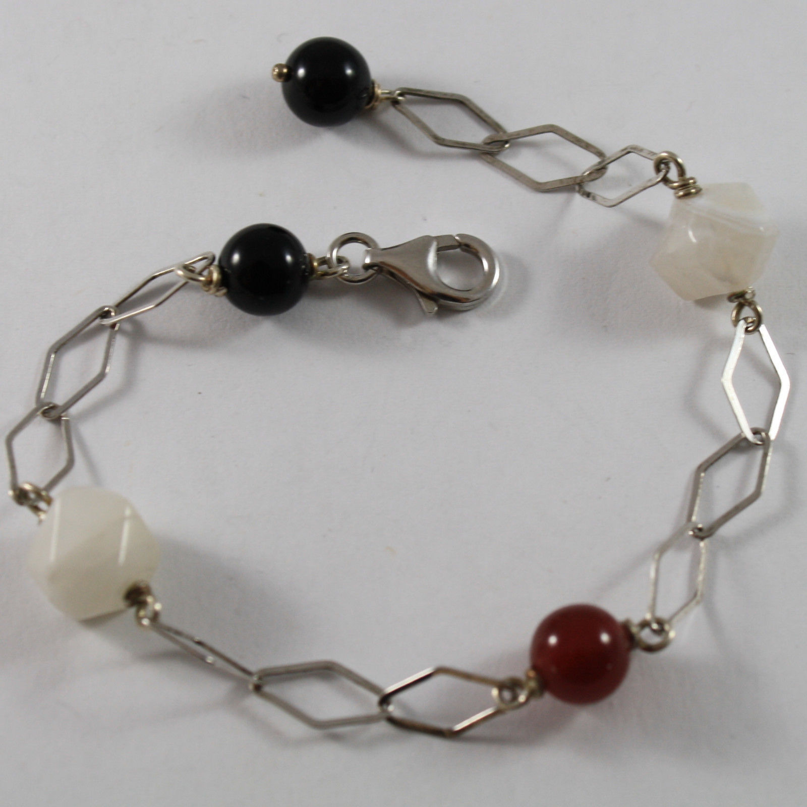 .925 RHODIUM SILVER BRACELET WITH BLACK ONYX, WHITE QUARTZ AND RED CARNELIAN