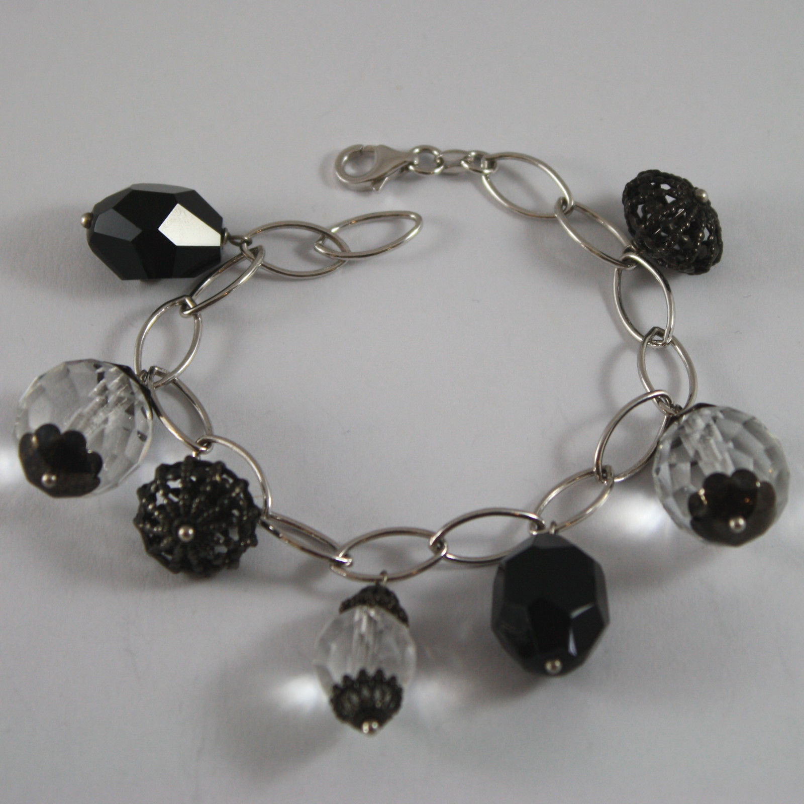 .925 RHODIUM SILVER BRACELET WITH BLACK ONYX, TRANSPARENT CRYSTALS AND CHARMS