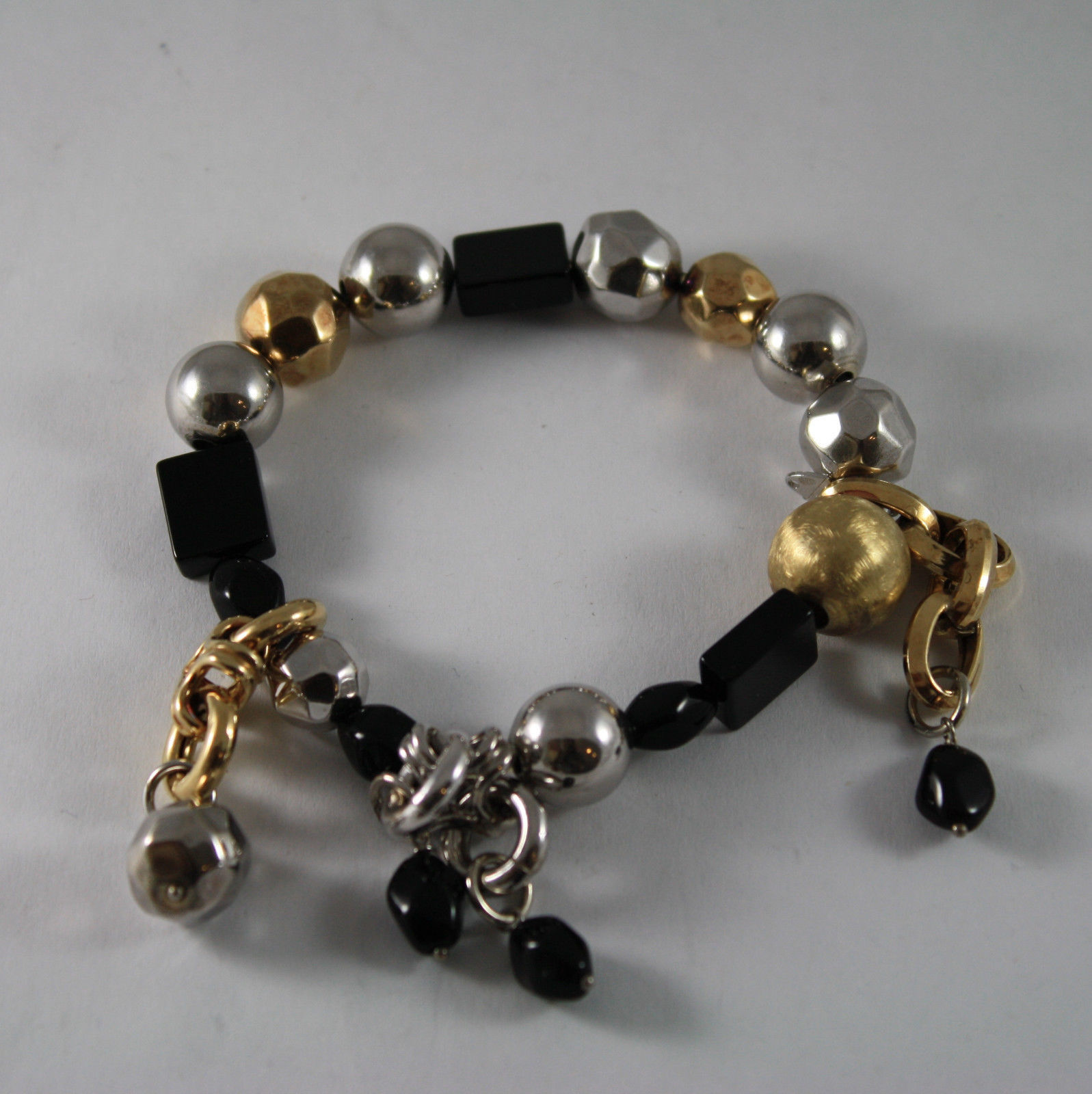 .925 RHODIUM SILVER AND ELASTIC BRACELET WITH BLACK ONYX AND GOLDEN SPHERE