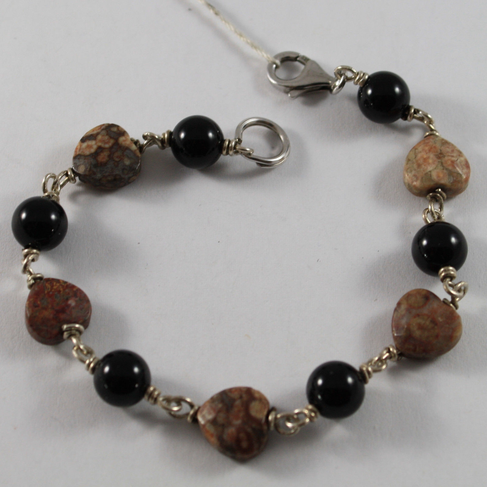 .925 RHODIUM SILVER BRACELET WITH BLACK ONYX AND HEARTS OF JASPER